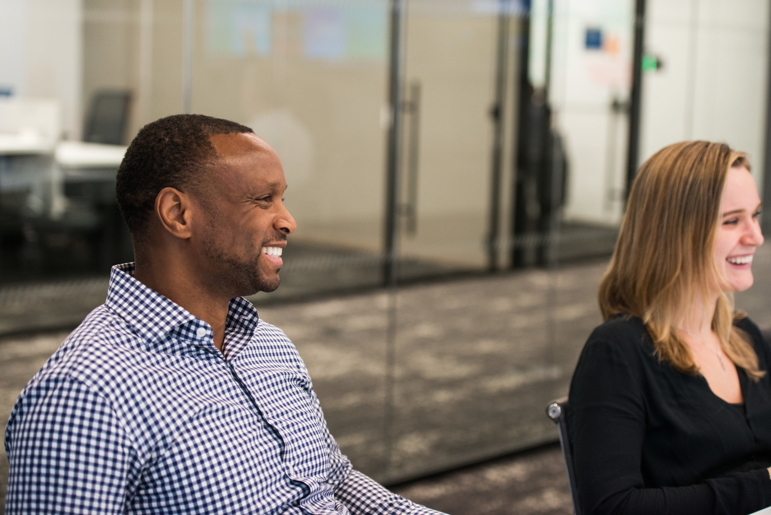 Two smiling Liquidnet employees discussing research and development in Liquidnet Labs