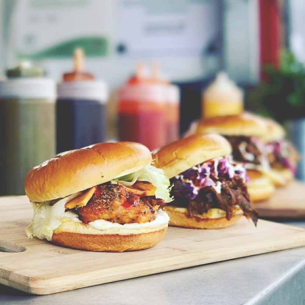 bandit street food - Smoked & slow roasted beef brisket, in a chilli, ginger, garlic & ale marinade, served with summer slaw, sour cream, Louisiana BBQ and a ghost chilli & bourbon sauce… rethink sliders at The Festival of Beer!