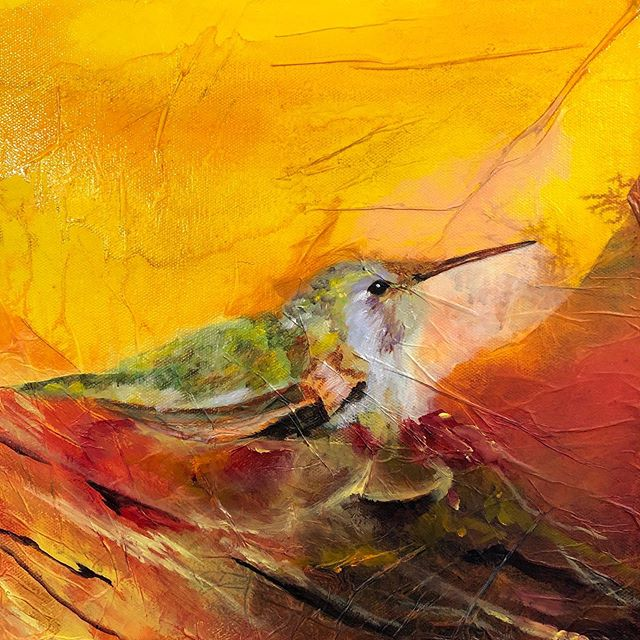 I am past basic roughing in stage and just starting the detail stage of the painting. It is still ugly. But, I am starting to see a little bit of life coming out of mama hummingbird. At this point I am starting to develop the layers of feathers on her. I am starting to build a nest, and continuing to build on the background. Working in oils is a process of building layers and developing depth. In order for this to dry quickly I will once again spray it with my quick dry.