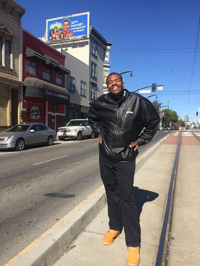 William Scott with Billboard in San Francisco, For Freedoms Project, November 2018