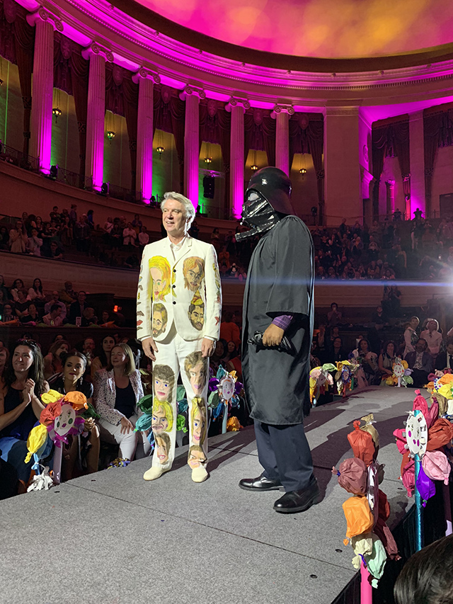 William Scott wearing a mask of his own design and Guest of Honor David Byrne wearing a suit designed by Kim Clark, photograph by Erica Chan Coffman