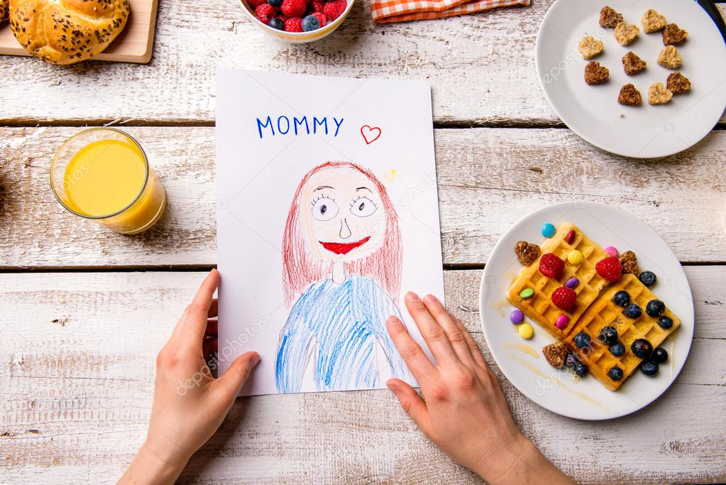 mothers day depositphotos_108296088-stock-photo-childs-drawing-of-her-mom.jpg