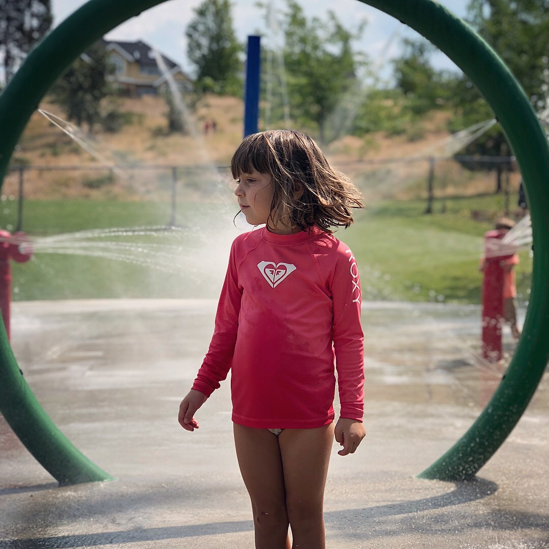 Beating the heat at Strathcona Park's splash pad in Kettle Valley