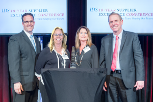 Cheri and Leslie accept Raytheon's IDS Four Star Supplier Excellence Award