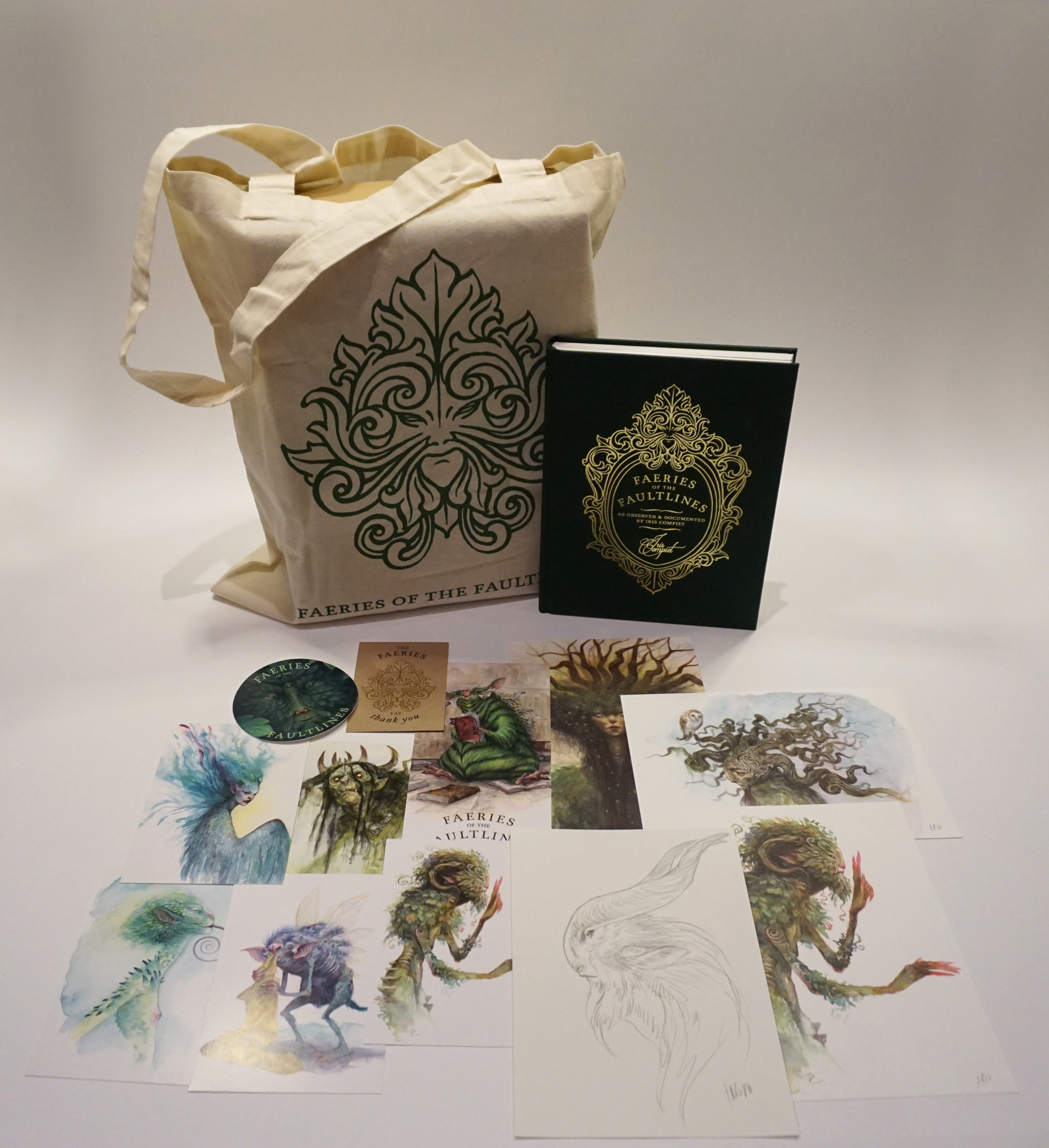 Fairies galore - This was my tier during the Kickstarter campaign, which included many goodies as you can see. Prints, postcards, stickers, an enamel pin, and an original sketch toget with the book and the bag.