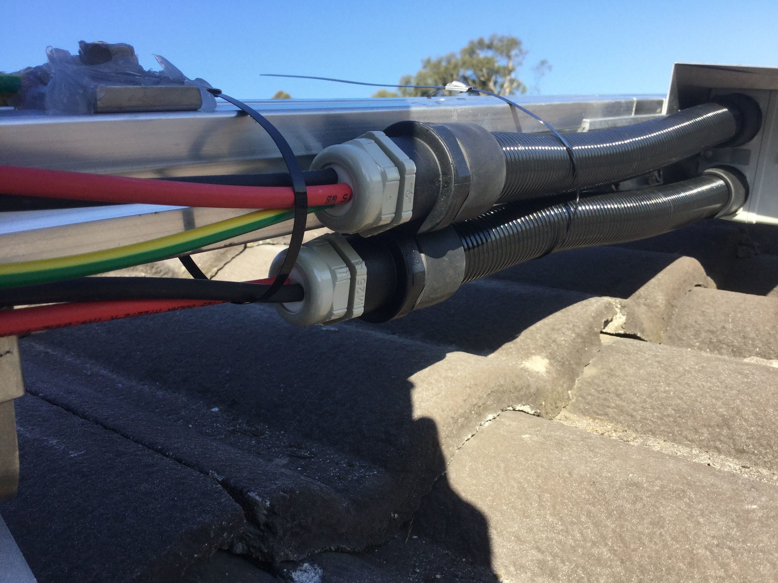 "Photo uploaded into iEnergytech's QC software ""Soorya"" and made available to the customer, shows the cable work on the roof."