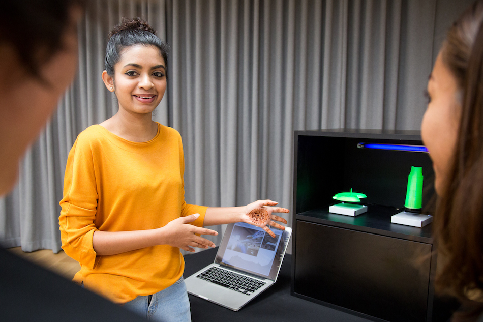 LASALLE College of the Arts student and multidisciplinary artist R. Yashini demonstrates her 3D printed artwork Sabaism, which draws attention to the phenomenon of light pollution in Singapore.[Image Courtesy of The MeshMinds Foundation].jpg