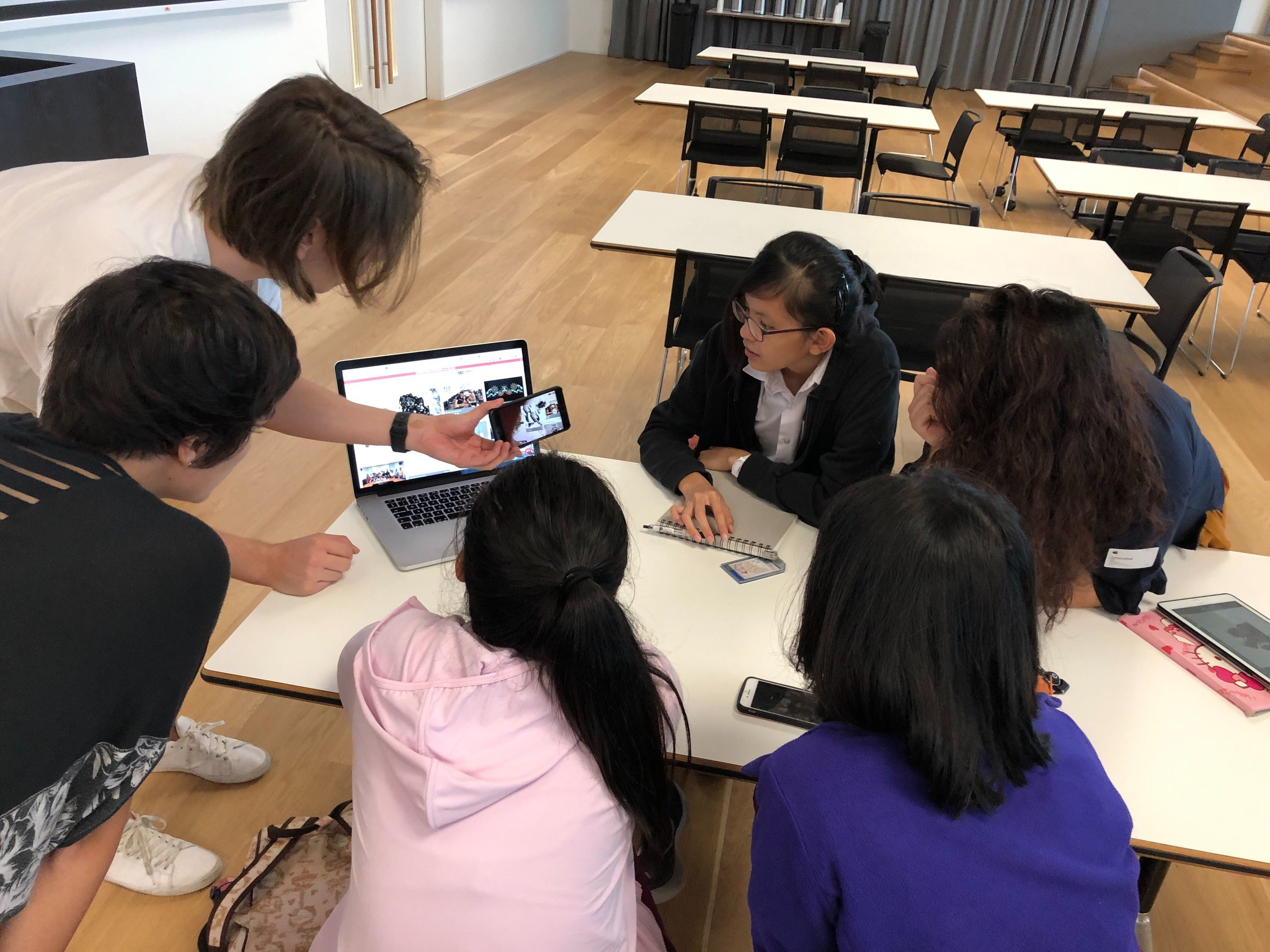 Our team demonstrating the use of Augmented Reality (AR) to the students.