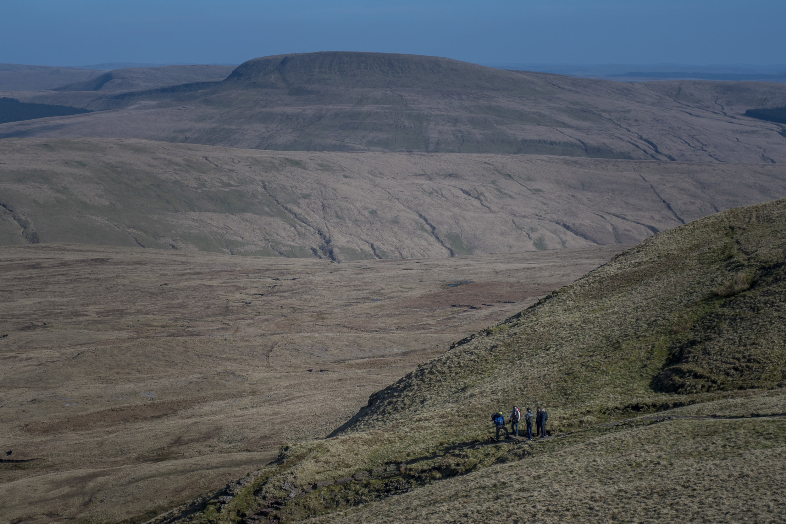 The scale of the mountains, even the gentler grassy ones of the Brecon Beacons, is never more evident than in this snap of the group