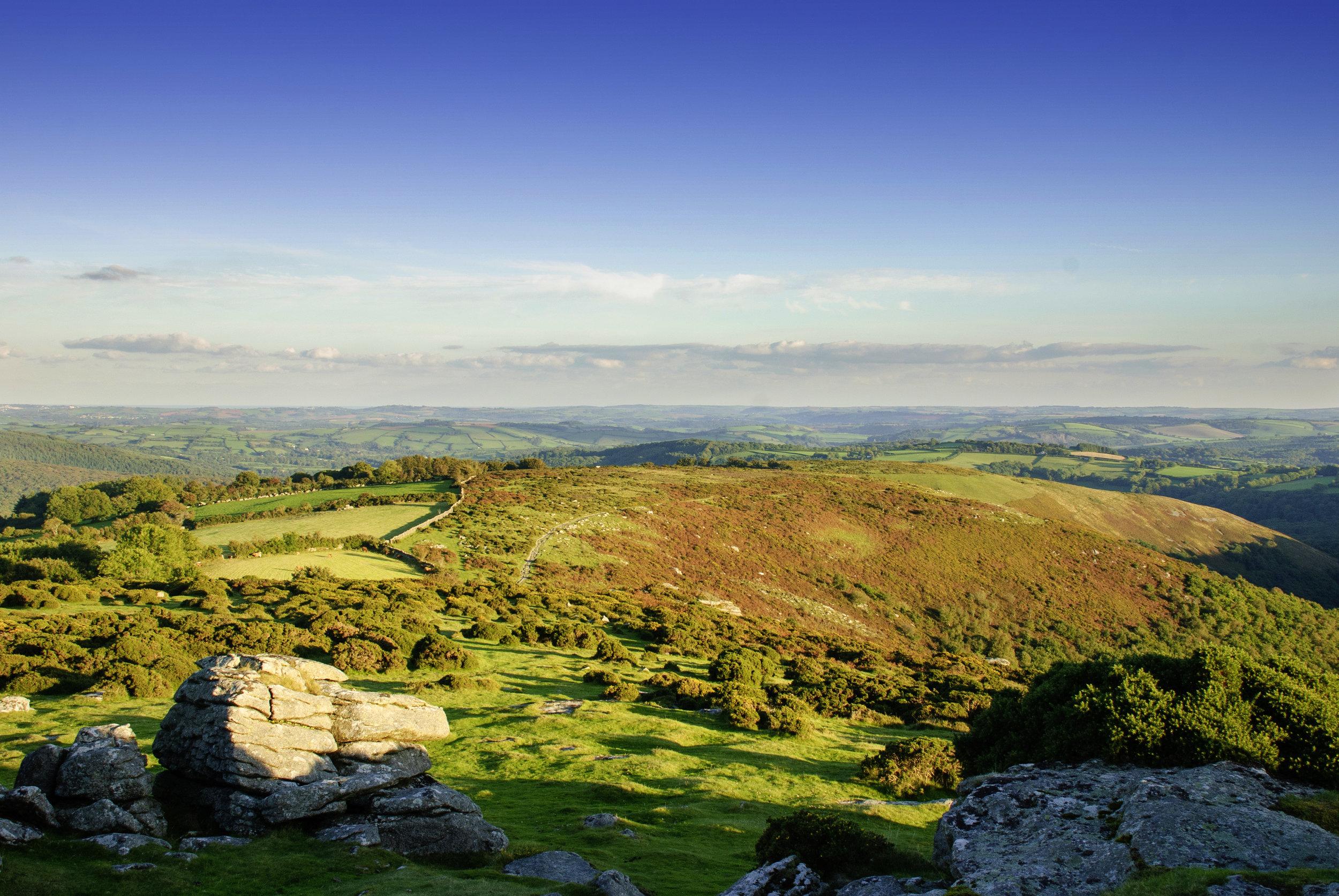 Dartmoor's rolling wilds seen from Mel Tor.
