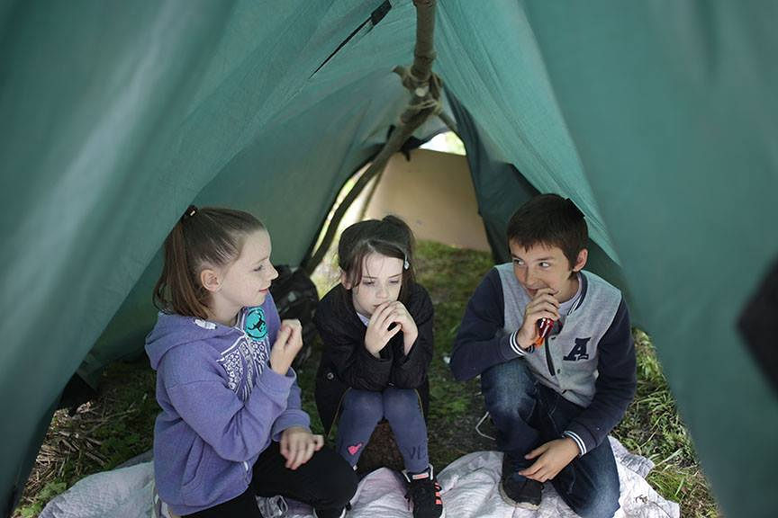- Build a social space using blankets, sticks or tarpaulin and ropes