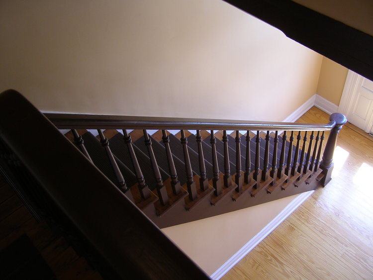 Canva - Brown Wooden Stairs in Front of White Wooden Door.jpg