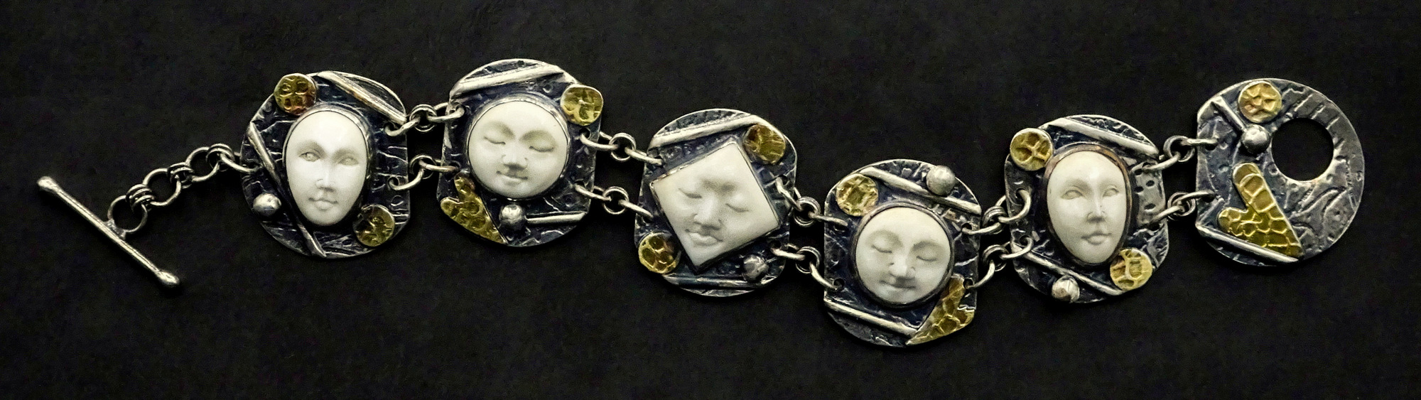 1-Sylvia McCollum, Handcrafted Faces of Courage, Fine Art Silver Jewelry-001.JPG