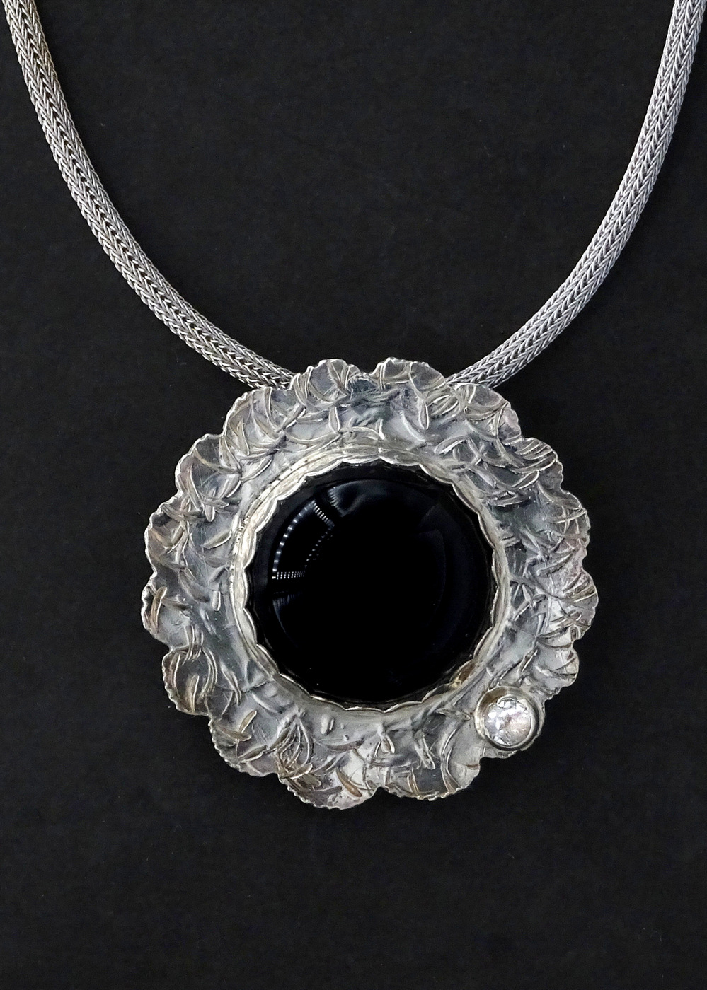 ROUND EMBOSSED PENDANT WITH BLACK STONE,  1.75 x 1.75 inches,  16 inch adjustable chain