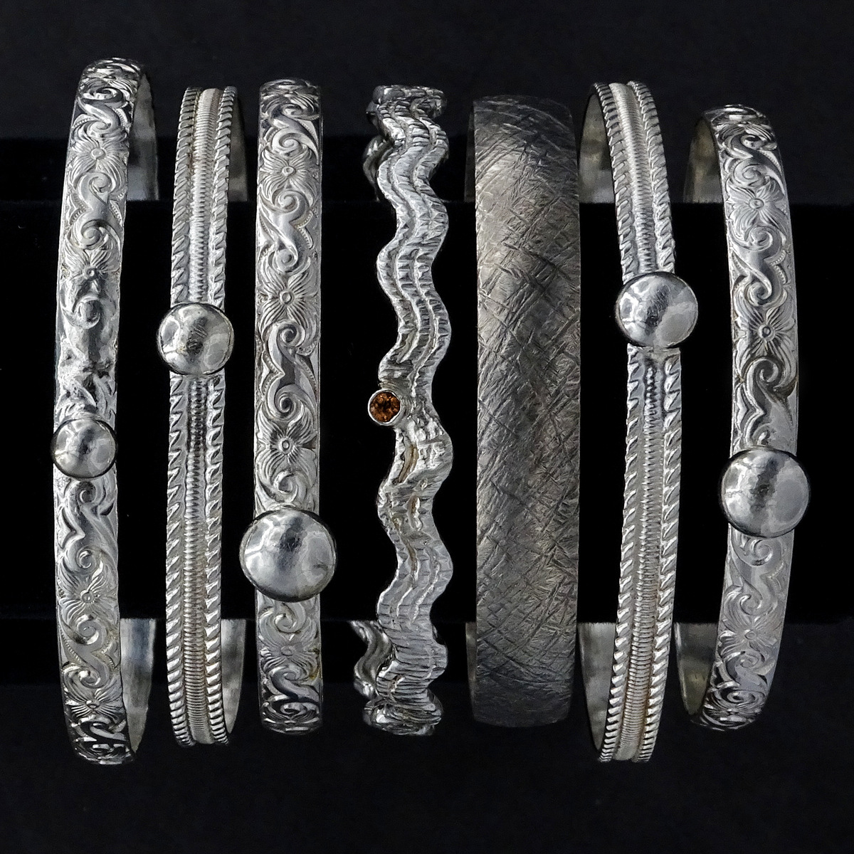 ASSORTED STUDDED & TEXTURED BANGLE BRACELETS,  2.5 inches in diameter