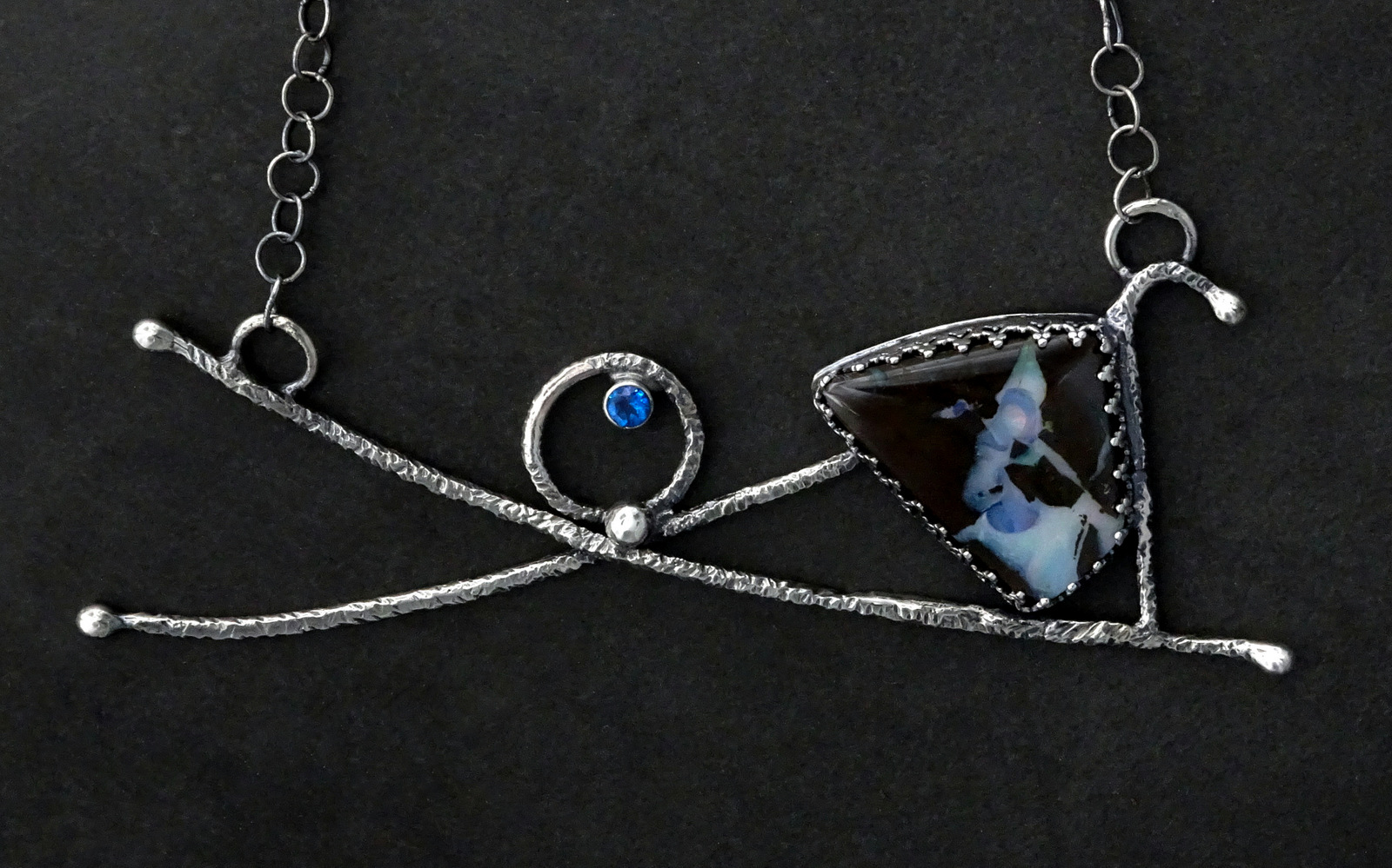SMALL DANCING SPIRIT NECKLACE WITH MOTTLED BLUE/BLACK STONE,  Pendant - 4.5 x 1.5 inches, Chain Length - 20 inches