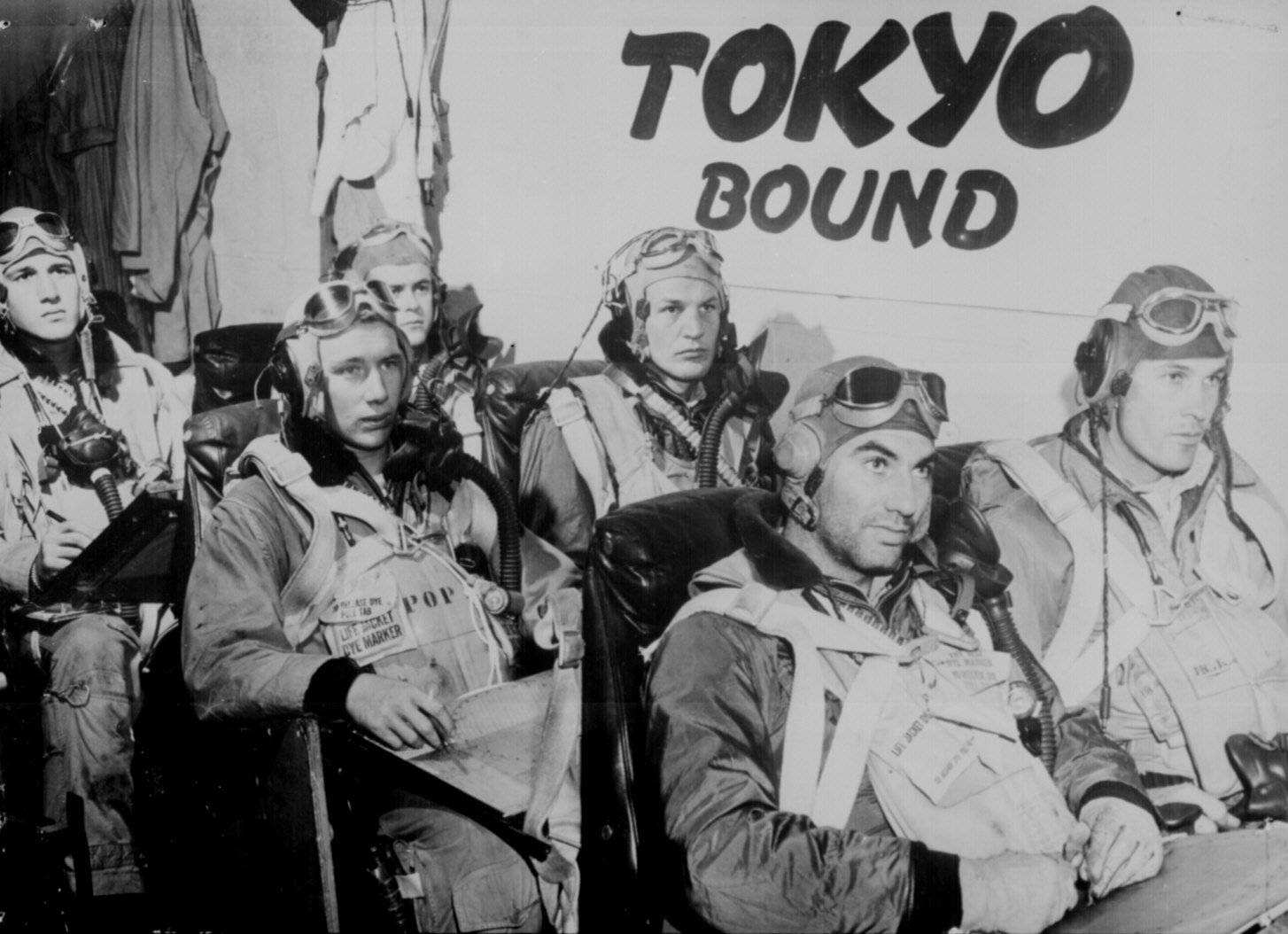 Pilots aboard a U.S. Navy aircraft carrier receive last minute instructions before taking off to attack industrial and military installations in Tokyo. February 17, 1945. National Archives.