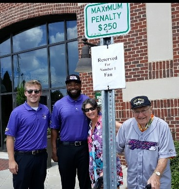 "Mike and Reggie with Dad and me. The valet staff kindly ""reserve"" a parking space for Dad at every game."