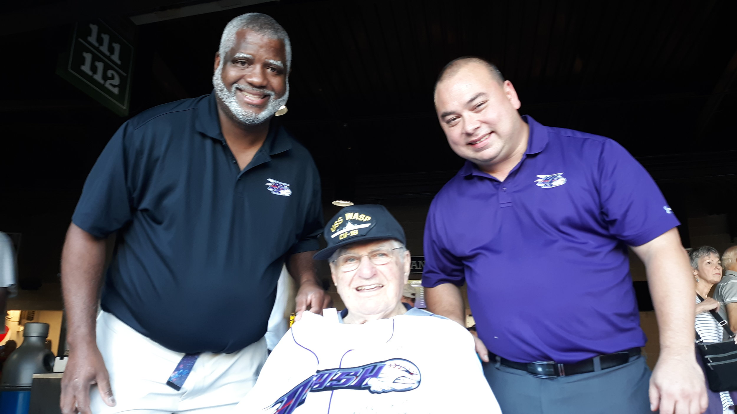 Dad's 70 game streak is recognized with a team jersey, presented by Clubhouse Manager Marlon Quattlebaum (left) and ballpark manager Kit Edwards (right). What doesn't show in the photo is that the jersey has been signed by all of the Winston-Salem Dash players.