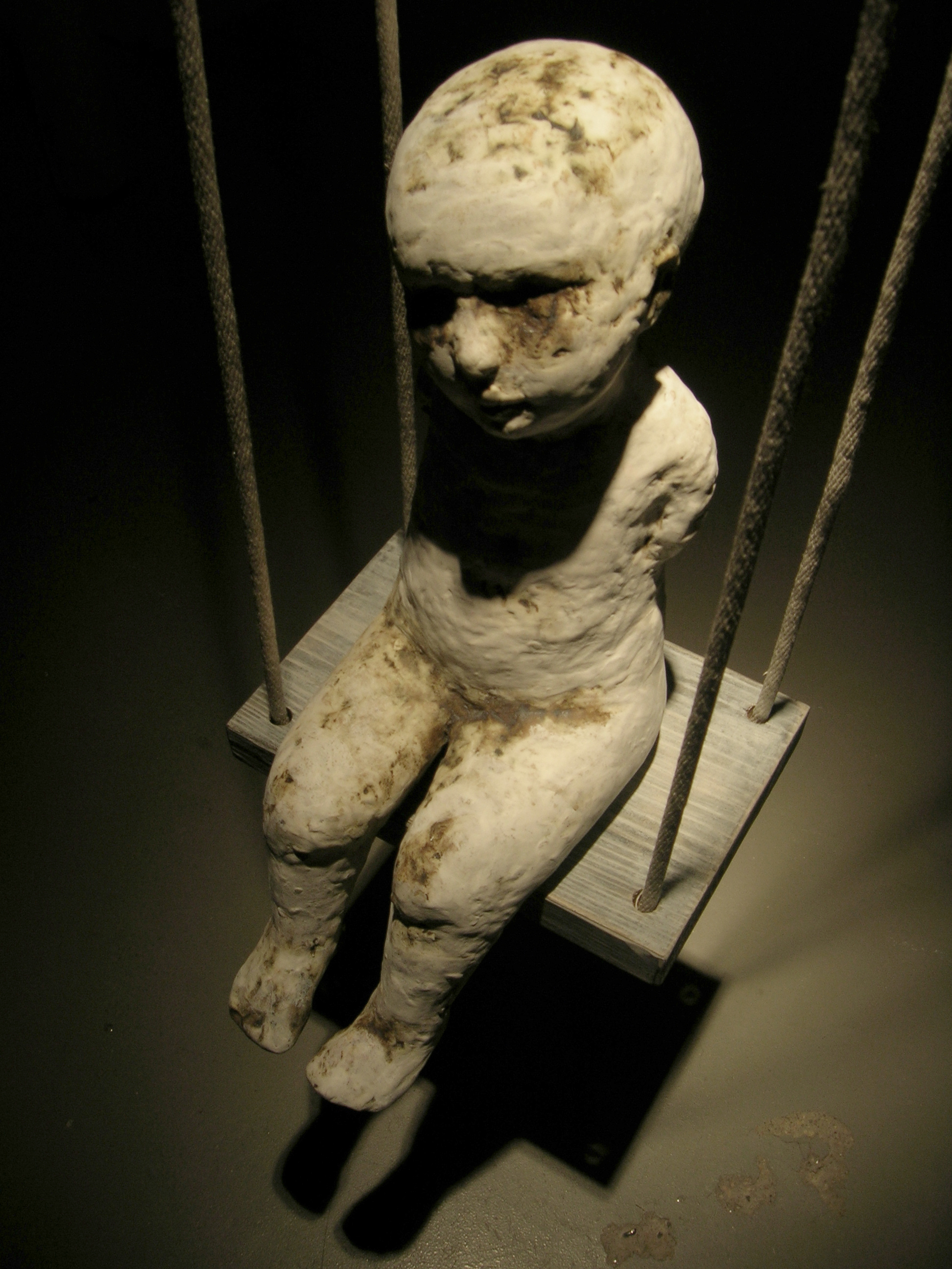 Falling Rope of Silence, 2005, Ceramic, rope, and wood.