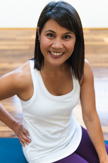 Lynnyoga instructor - Lynn believes that life is loud! It can be easy to miss the messages from within because of all the input and activity in the day. Through over 15 years of practice, Lynn feels yoga teaches students how to get quieter regardless of the volume and chaos around them.Through sharing the yoga practice, she encourages a curious heart and an inquiring mind in her students. Lynn aims to make class inspiring, exhausting, and full of fun. She encourages Svadhyaya (self study) in students to humbly push their daily limits and then reside in contentment. She is known for mixing her thoughtful class sequences, yoga philosophies and eclectic music delivering each class as a one-of-a-kind experience. Lynn blends alignment, anatomy, and energy in her cues so each student can find the shape of the poses that best suits the individual. Through the challenges in class, students can begin to see past their immediate reactions and uncover compassion for the self. Lynn encourages her students to listen to themselves and gracefully ride the ebbs and flow in life with a sense of humor and a light heart.Lynn has been teaching yoga for over 13 years in the Midwest. She loves an eclectic practice balancing the energy of hot, sweaty vinyasa flow with the grounding of a slow, cool yin class. Lynn has had the privilege of training and mentoring yoga teachers for the last 6 years and is honored to co-lead Satyam Teacher Training at Om Oasis.