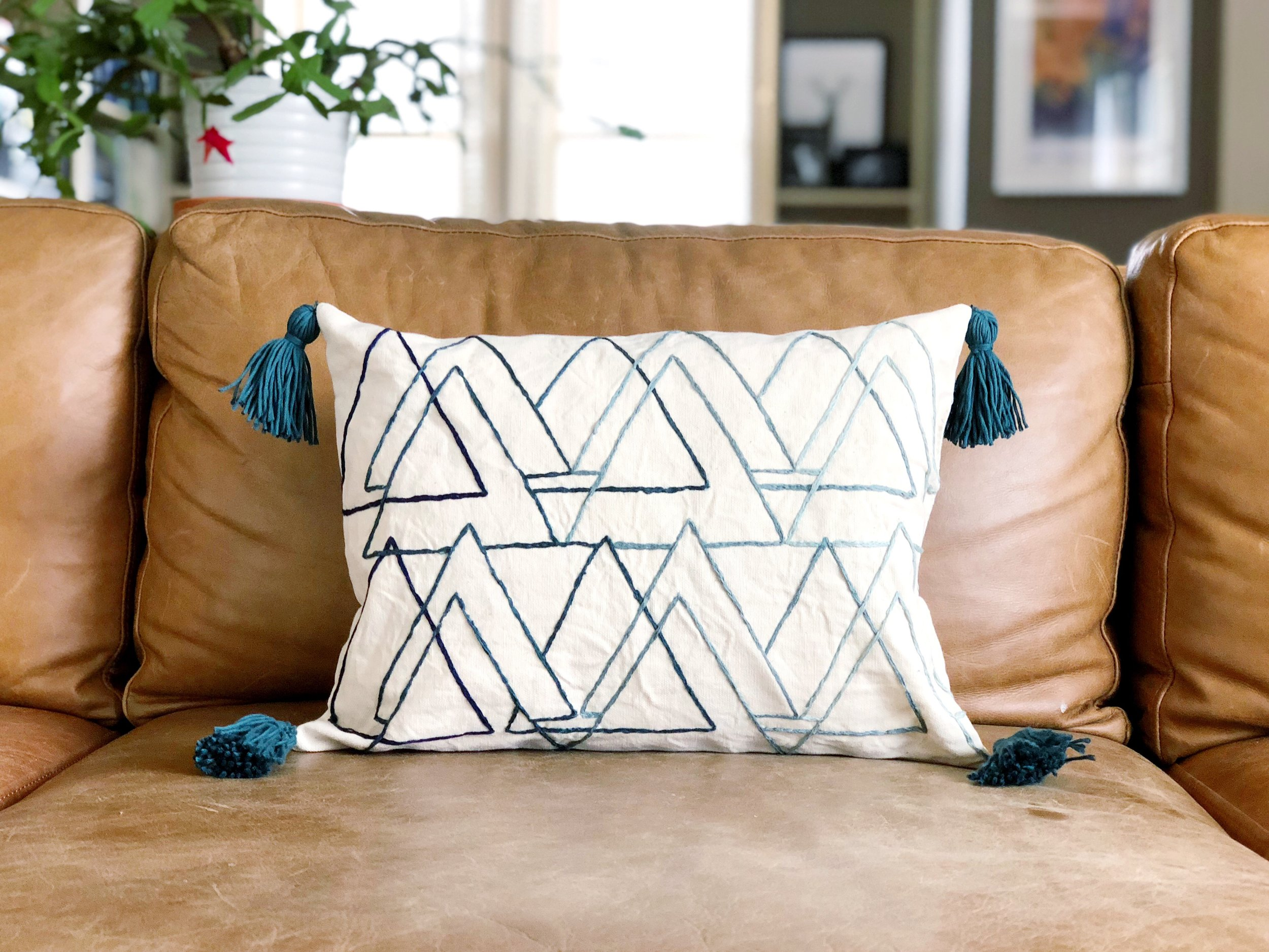 magnolia market inspired embroidered pillow with tassels.jpg