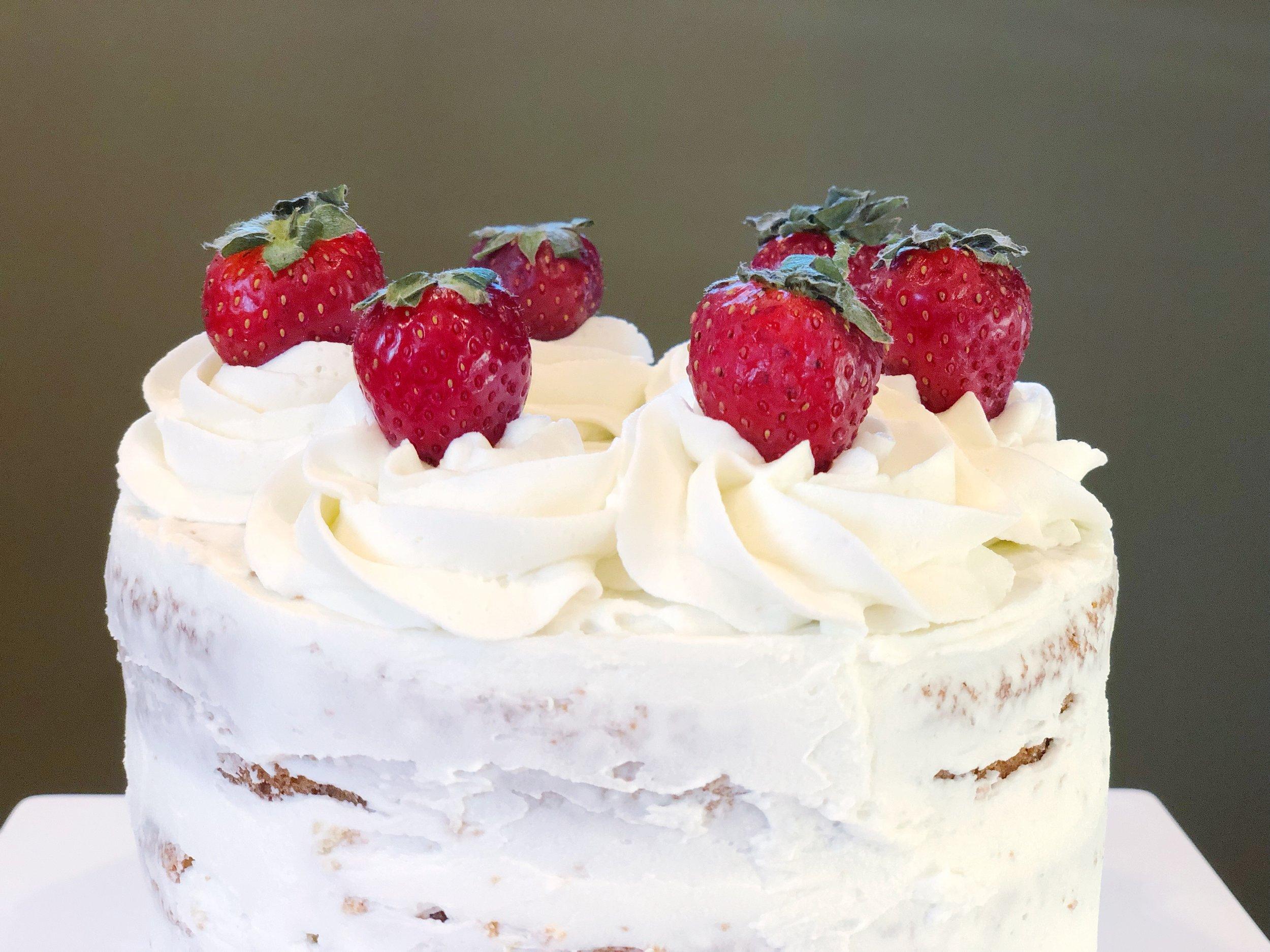 strawberries on my hacked cake mix bakery cake.jpg