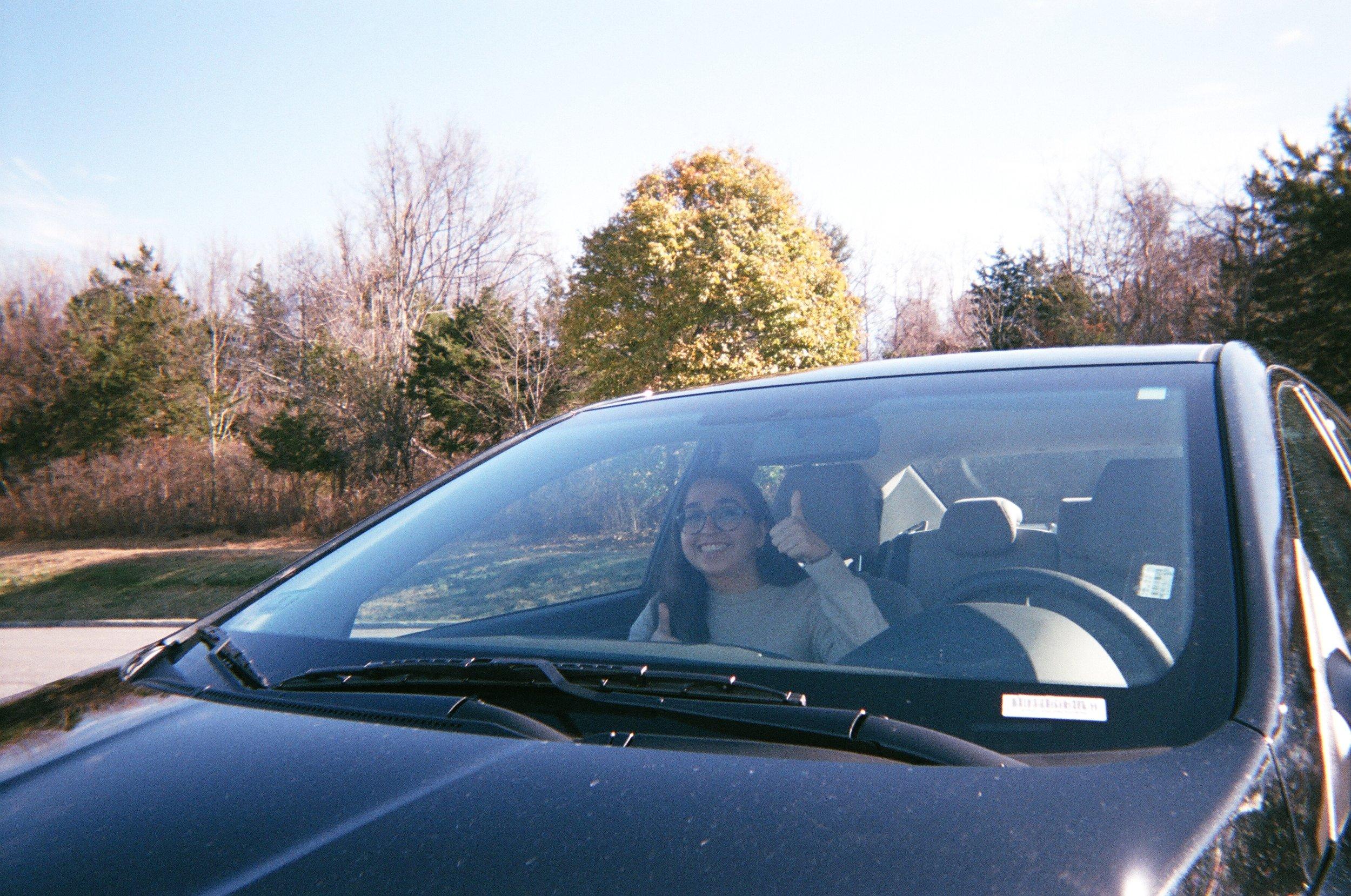 Kiana in our beloved rented Honda, Genoise.