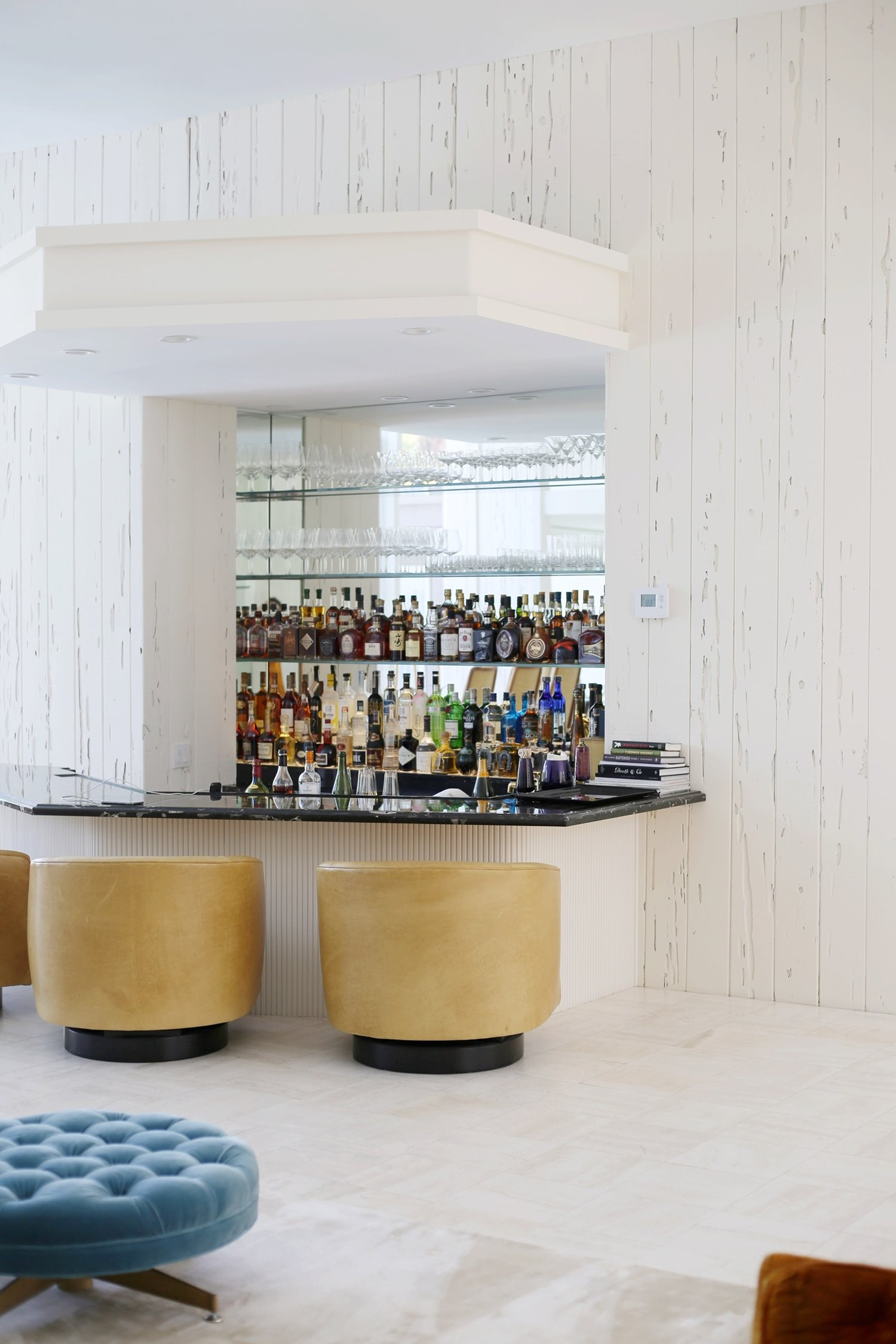 Classical mid-century bar by Jeff Vance with original bar chairs by Milo Baughman .
