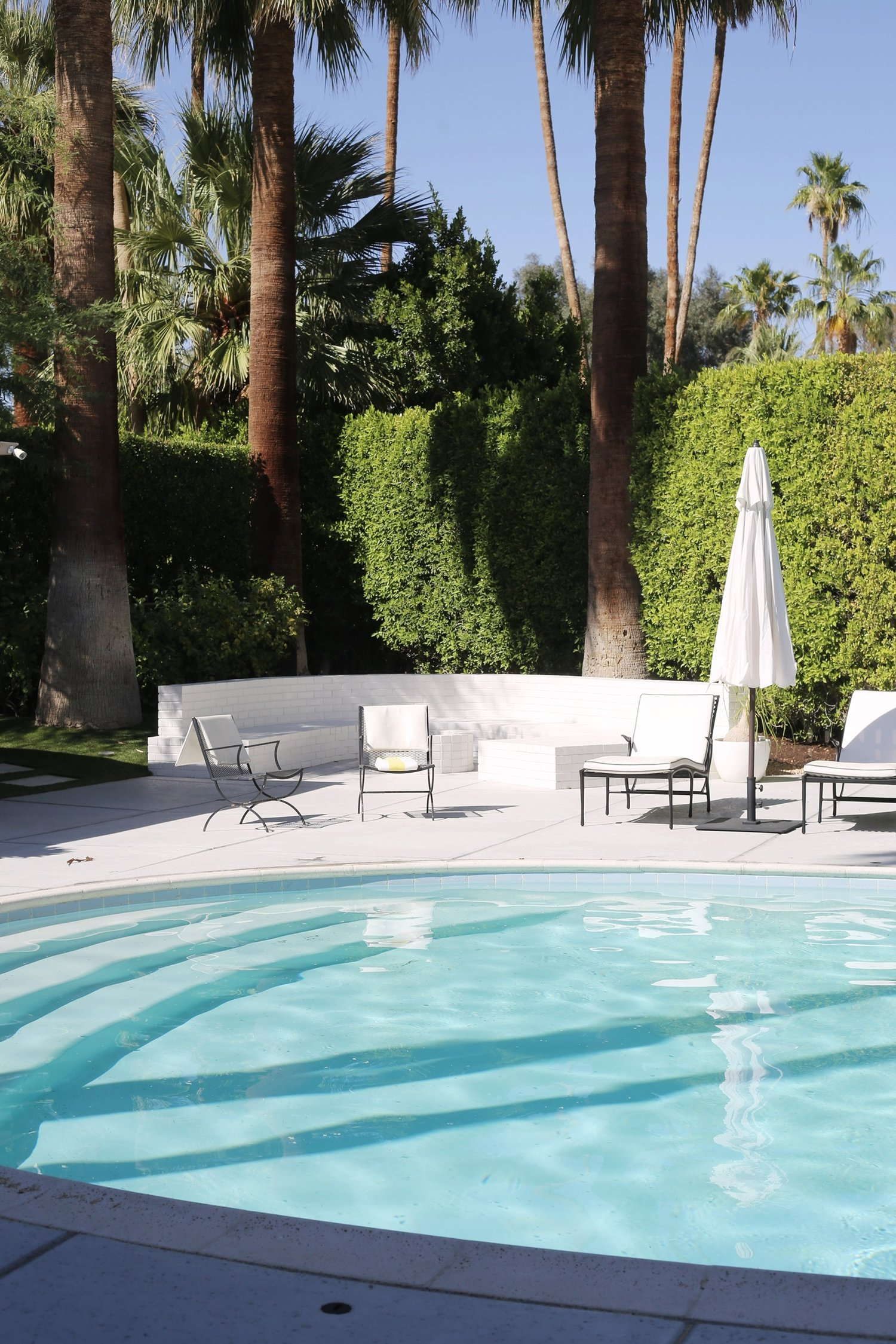 Pool chairs by Woodard with outdoor design by iD Group.