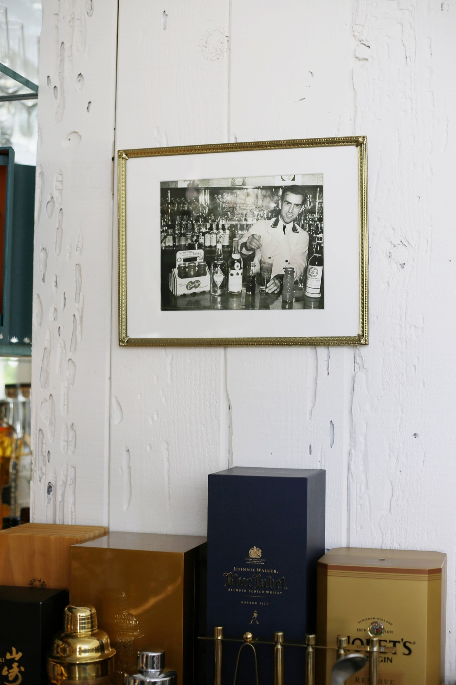 Original photography of Lloyd Vance, grandfather of Jeff Vance, bartending at a bar in Hollywood in the 1940s hanging up in original bar by Jeff Vance.