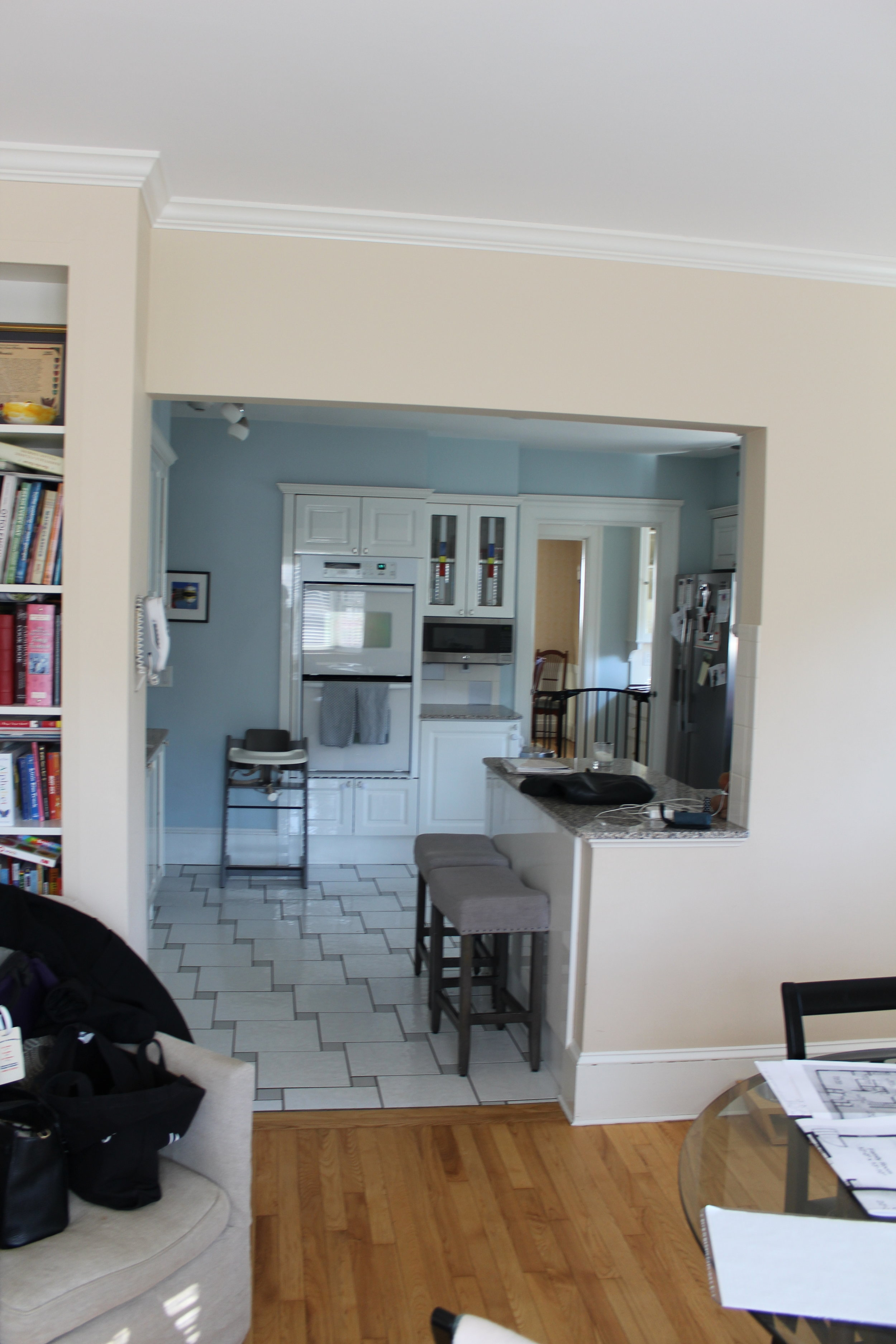 A closed-off kitchen adjacent to a room off the back of the house was dark, cluttered and claustrophobic.