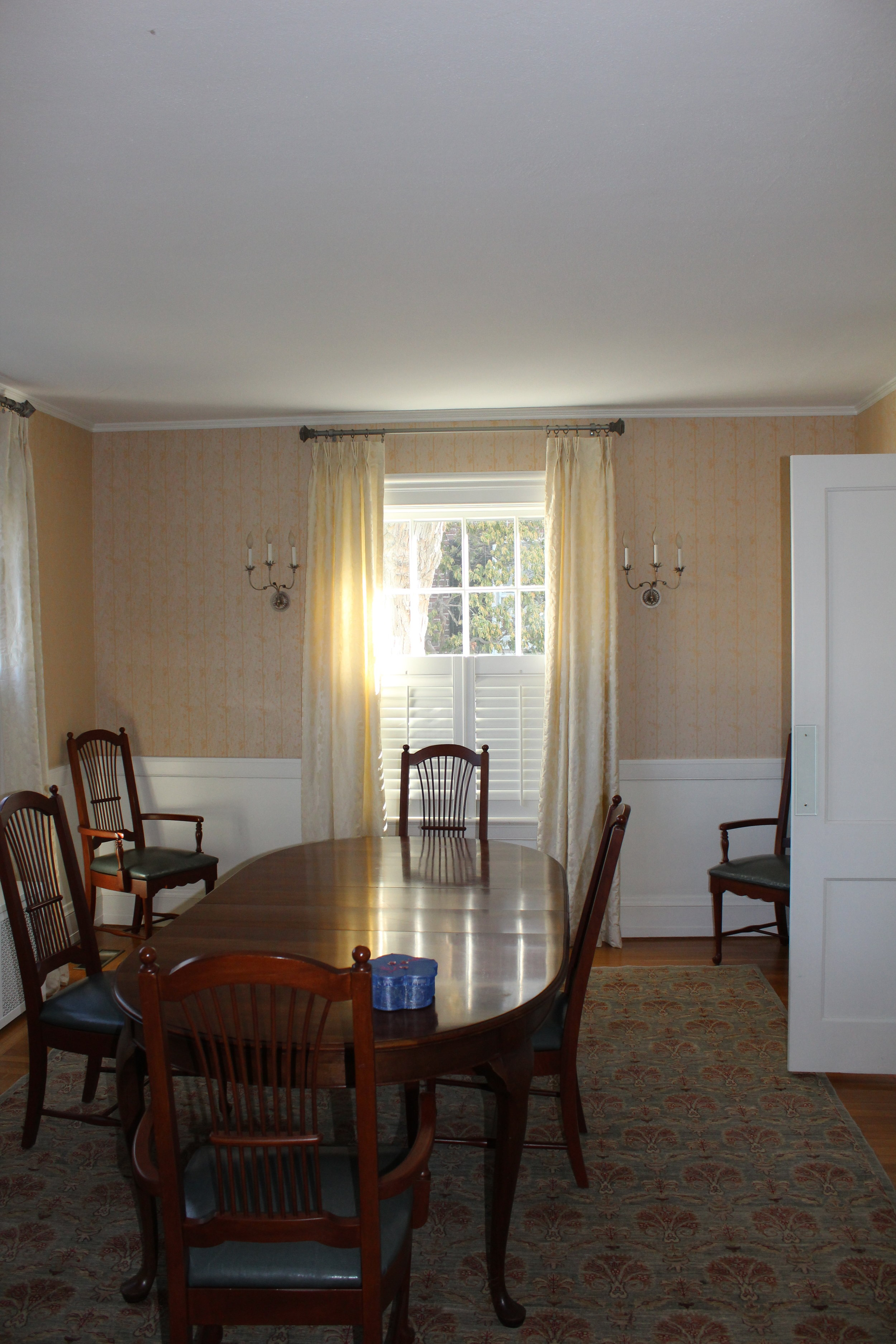 The dining room, full of windows, was far too dark for their liking and isolated from the rest of the first floor.