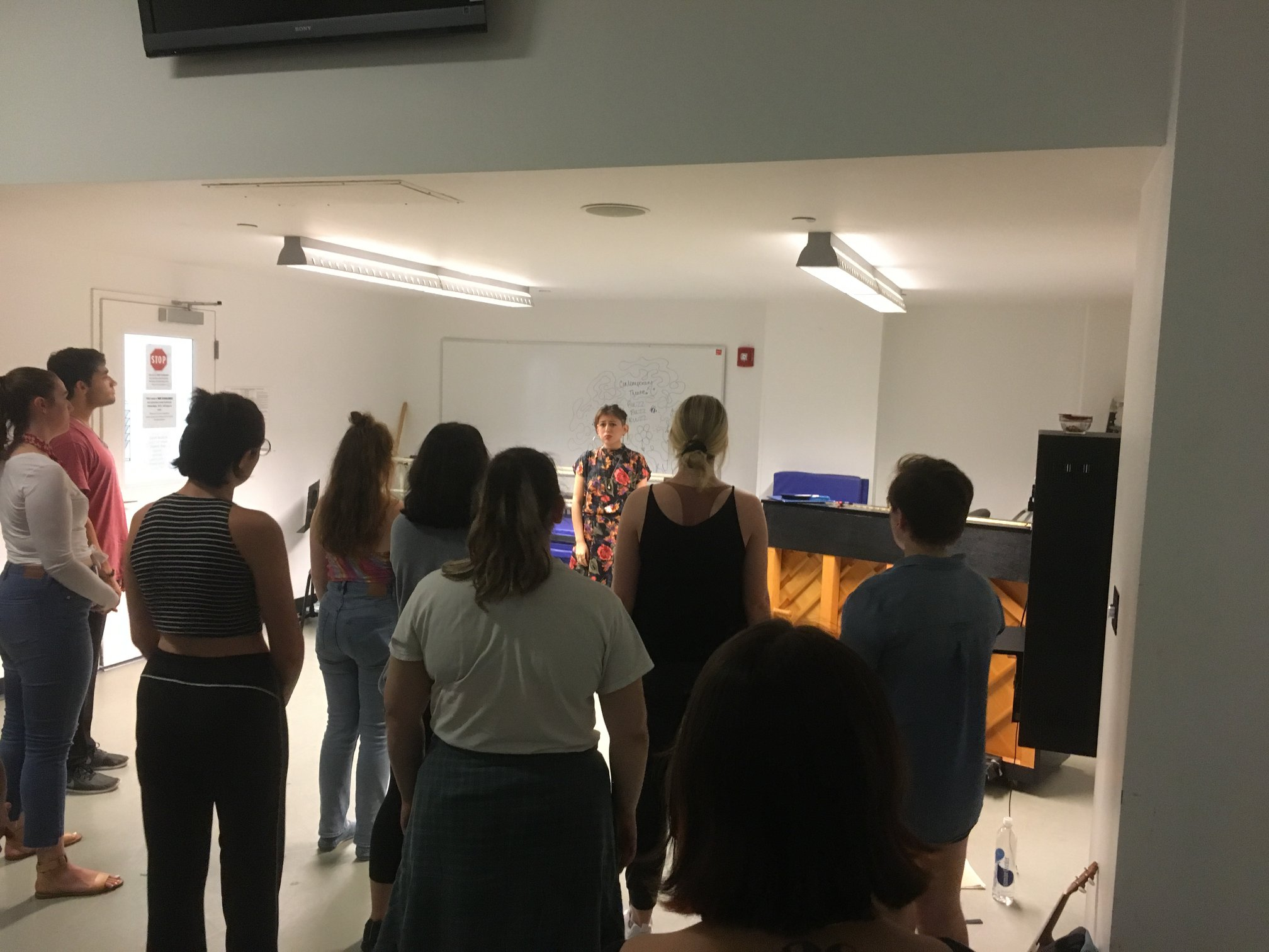 Group vocal rehearsal with ensemble. Photo by Theresa Lang.
