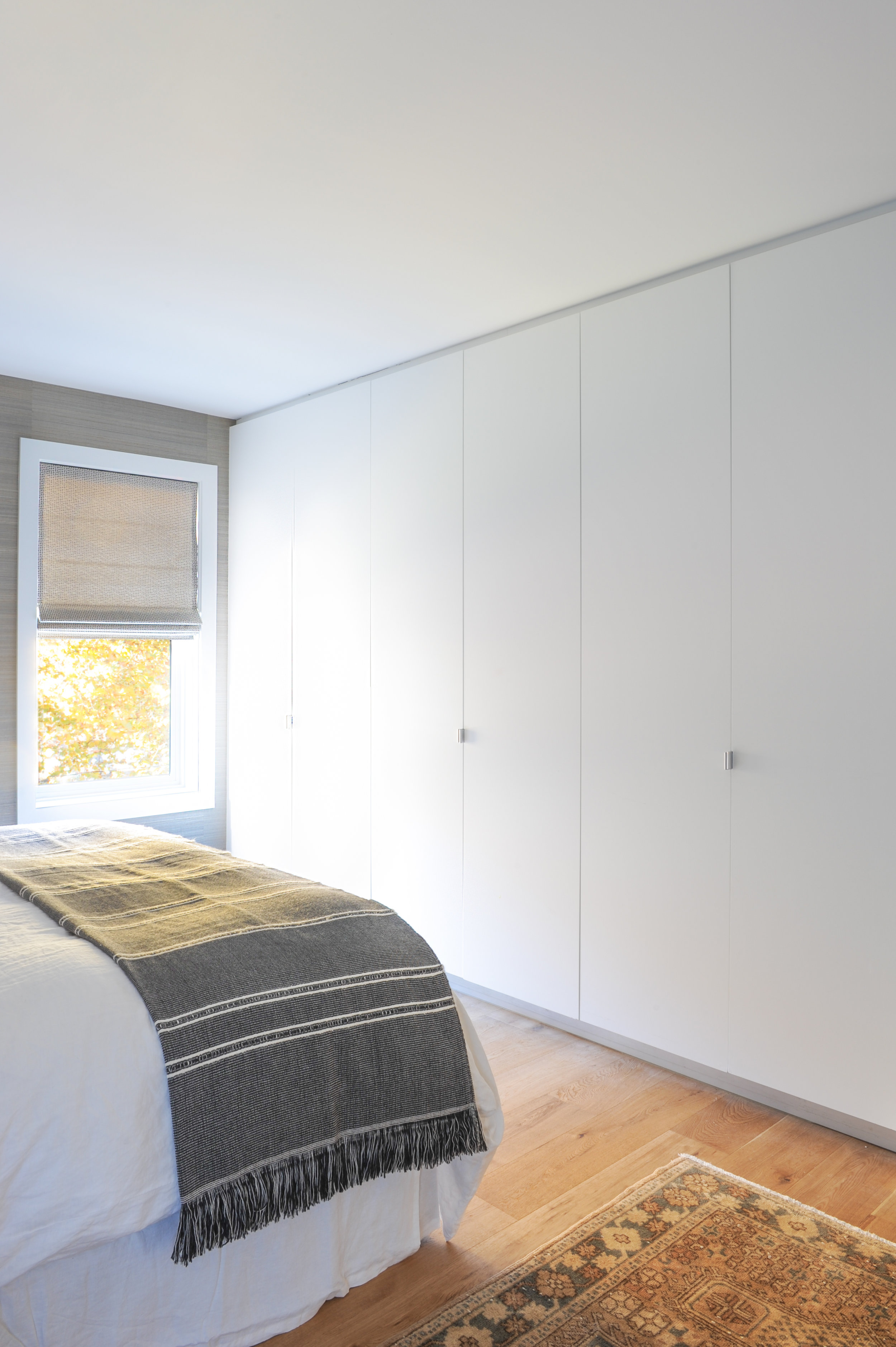The bedroom is fitted with large floor to ceiling closet doors,