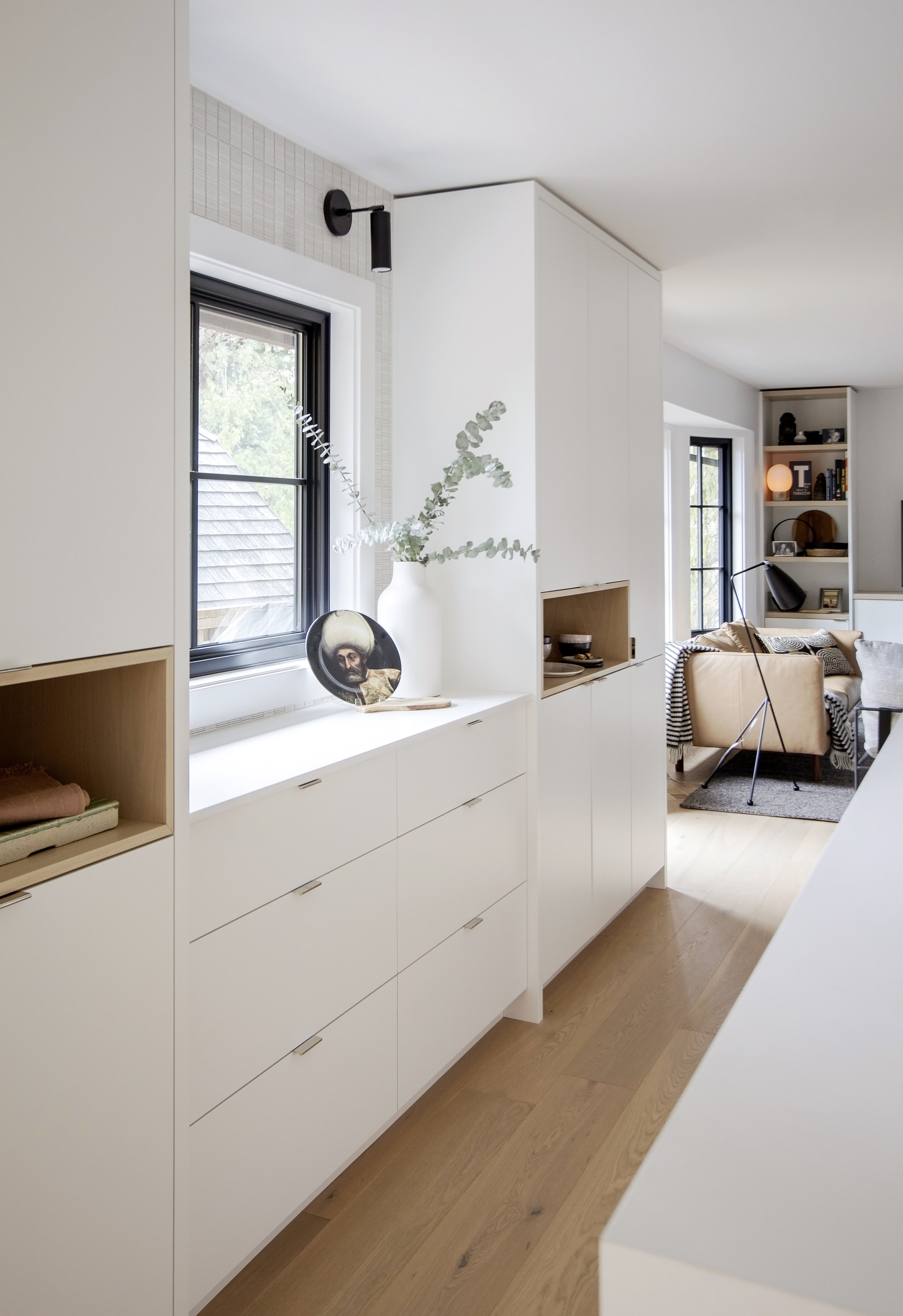 The kitchen of Alderfield place; brightly lit, white counter tops and drawers offer tons of bright cheeriness.