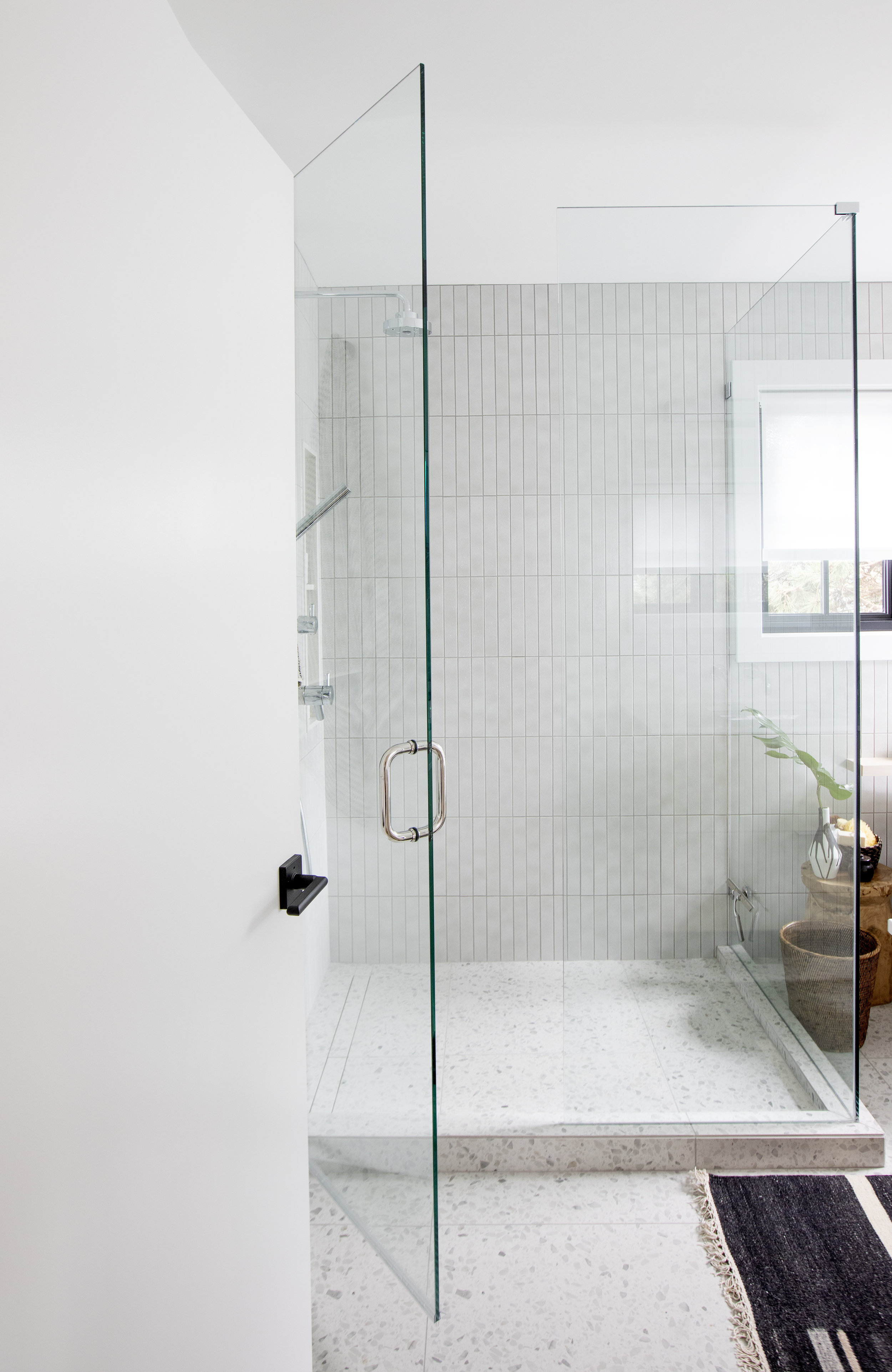 The master bathroom at Alderfield place features a large, luxurious walk in shower