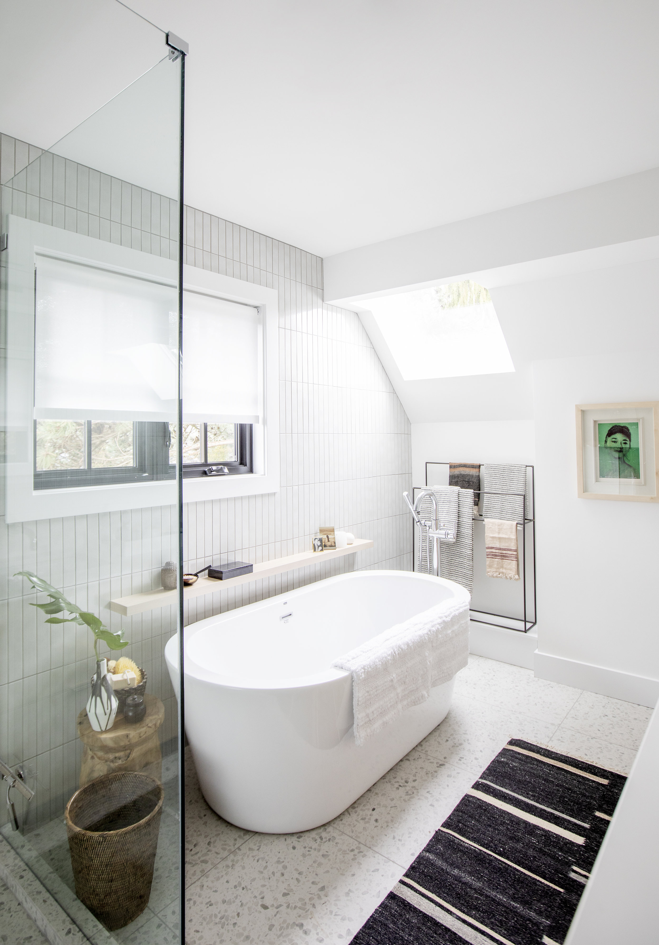 A luxurious soaker tub sits in the middle of the master bathroom at Alderfield Place.