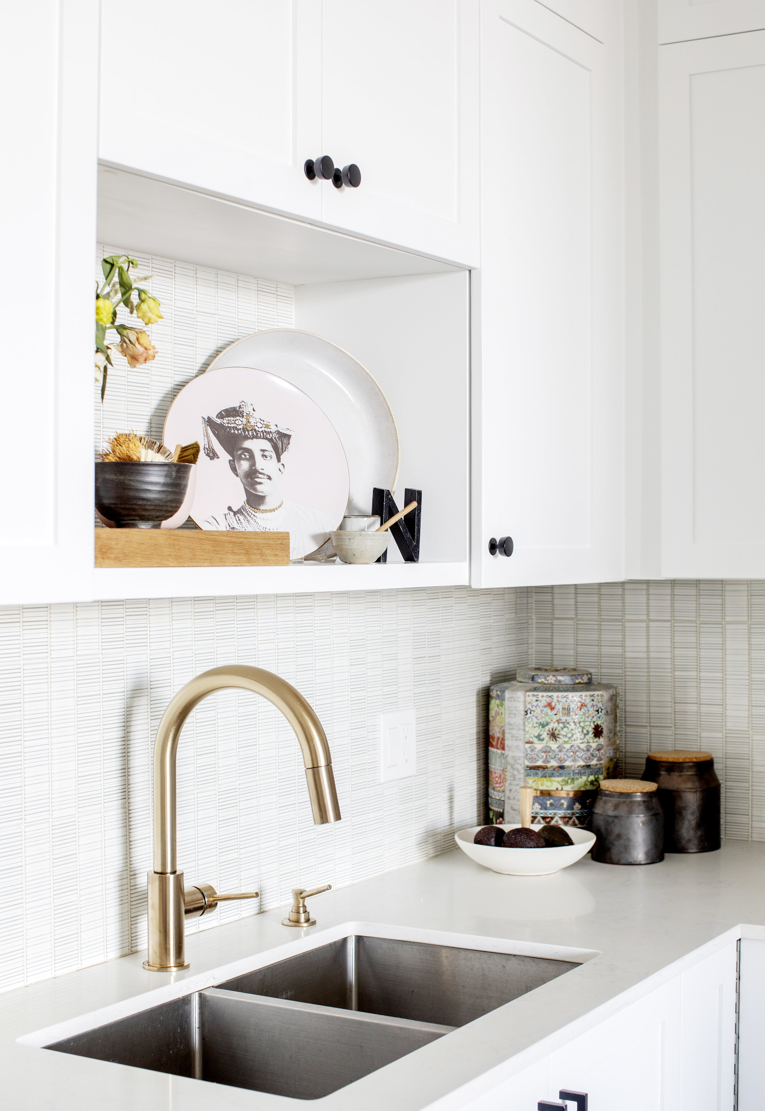 The kitchen sink at Prince Edward Street, featuring a gold faucet and double sinks