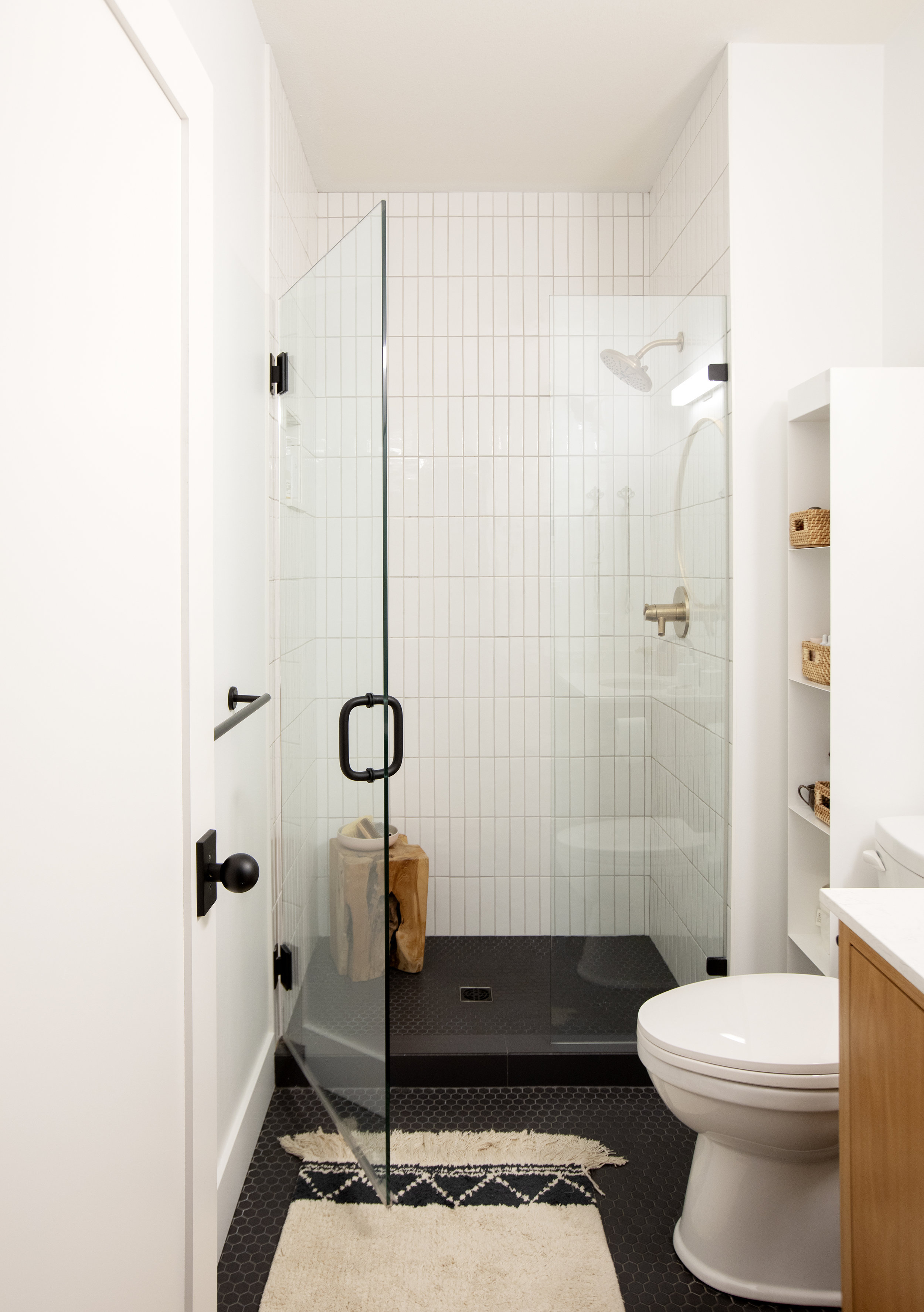 The bathroom at Prince Edward Street includes a large walk-in shower with vertical rectangular accent tiles.