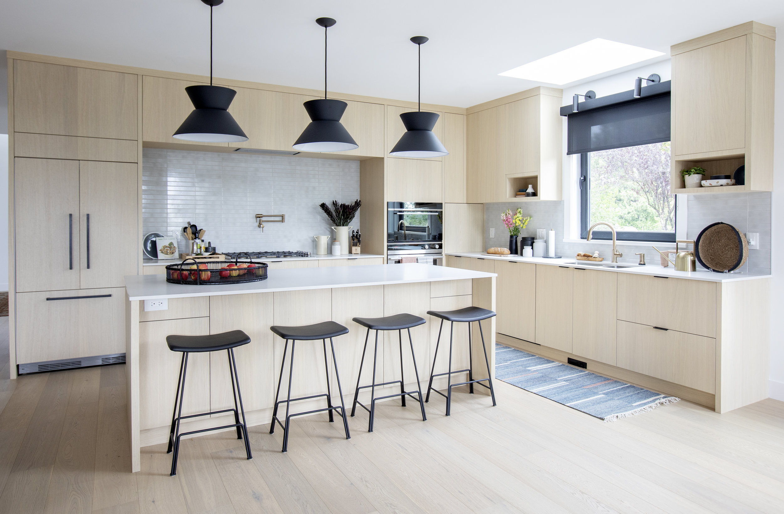 A wide shot of the modern and beautiful kitchen in East 13th street.