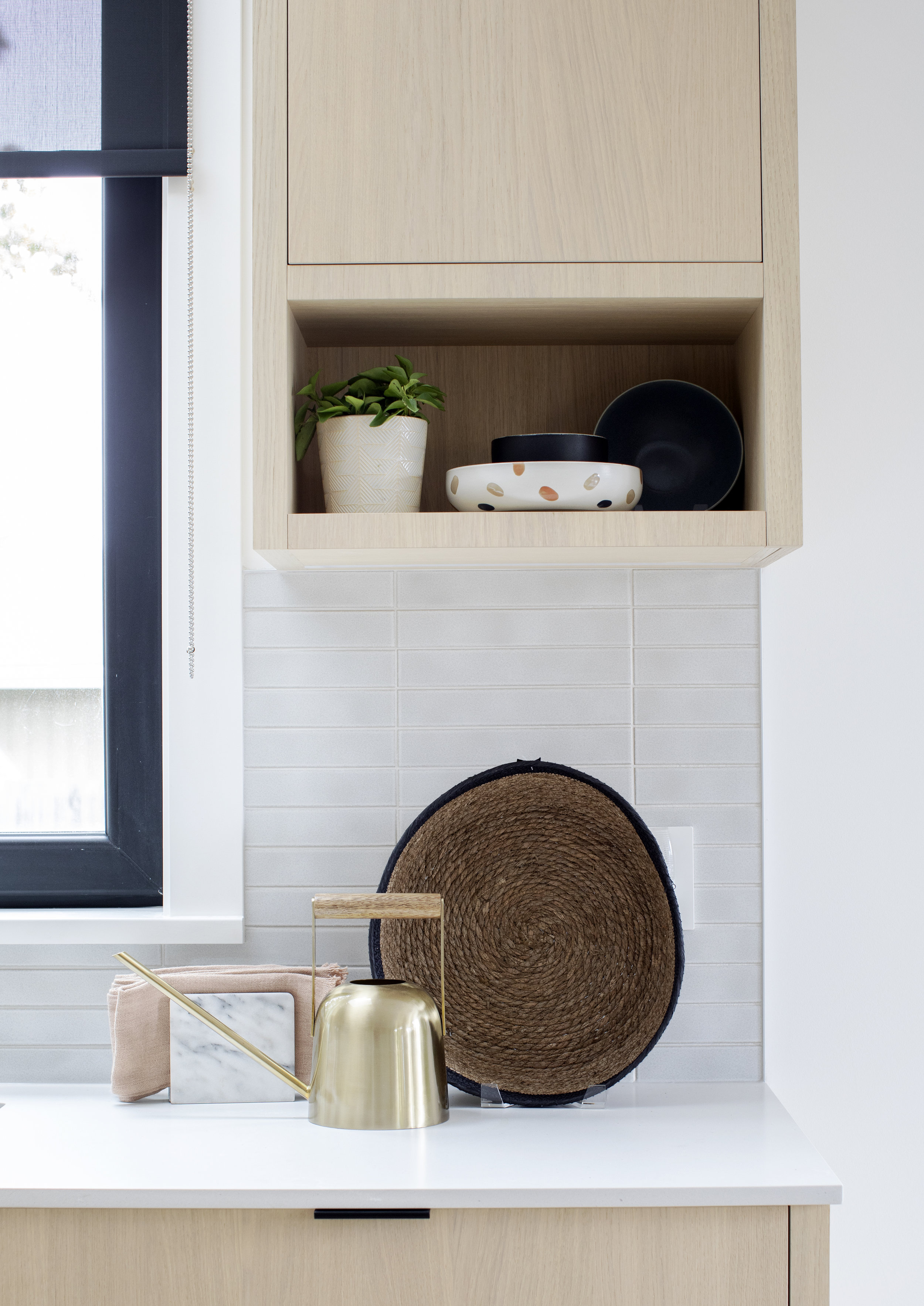 Decorative pieces give the kitchen in East 13th Street a homey touch