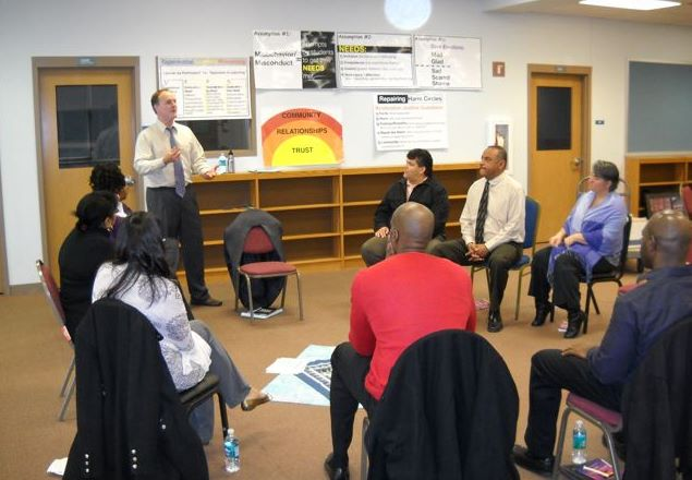 Paul facilitating a restorative justice circle training with community colleagues for the Milwaukee Public Schools, Wisconsin Conservatory of Lifelong Learning (WCLL), 2012.