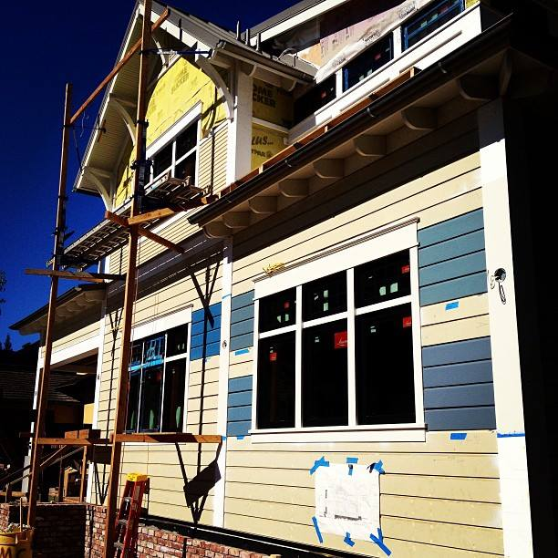 Testing paint colors in the sun light on the Net Zero Passive House in Palo Alto.