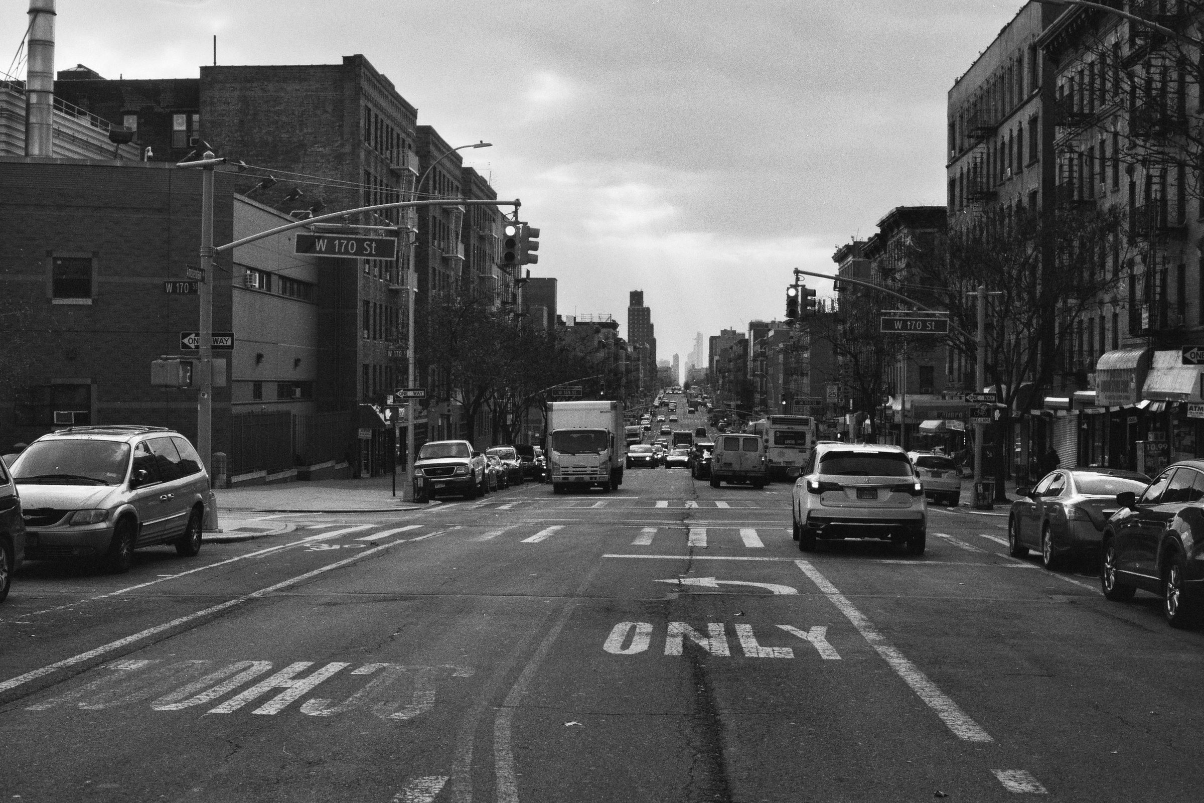 170th and Amsterdam in Washington Heights, looking south.  Details :    film, 35mm Ilford Delta 400. Pentax K1000. Fletcher Berryman, 2018.