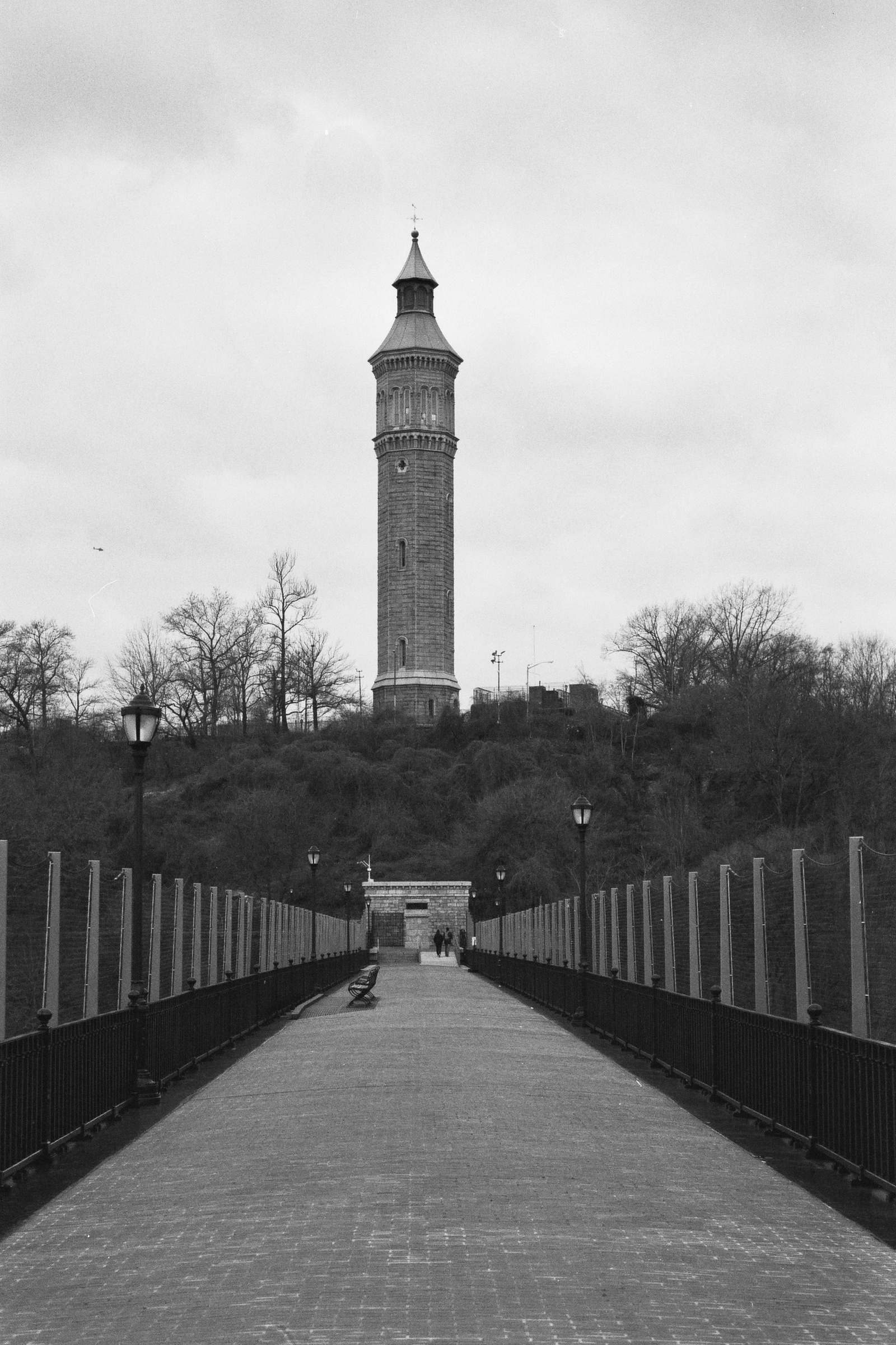 The High Bridge Water Tower as seen from the bridge, looking back towards Washington Heights. New York City.  Details :  film, 35mm Ilford Delta 400. Pentax K1000. Fletcher Berryman, 2018.