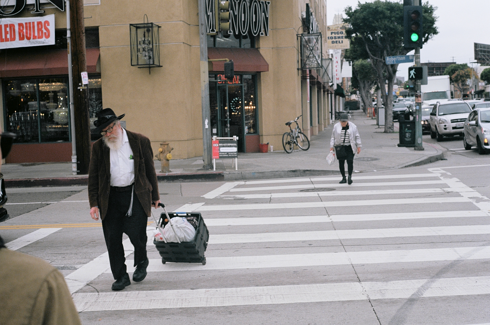 Crossing over Robertson Blvd along Pico. Pico-Robertson, Los Angeles.  Kodak Ektar 100. Pentax K1000. Fletcher Berryman 2019.