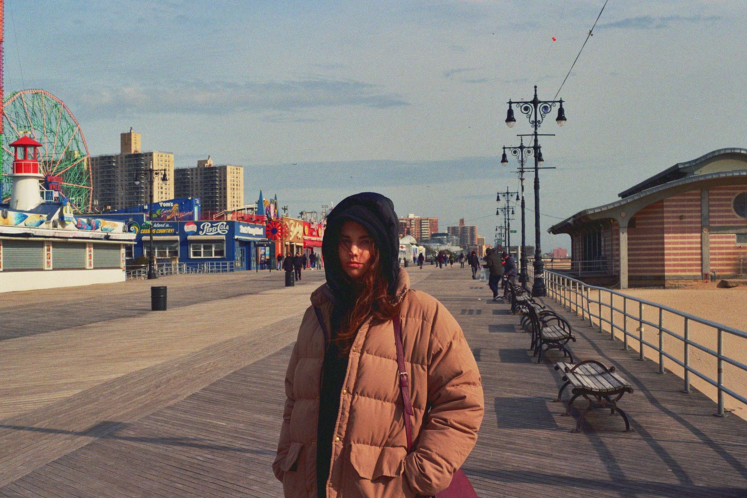 Standard beach attire for a January boardwalk stroll.  Kodak Ultra Max 400. Pentax K1000. Fletcher Berryman 2019.