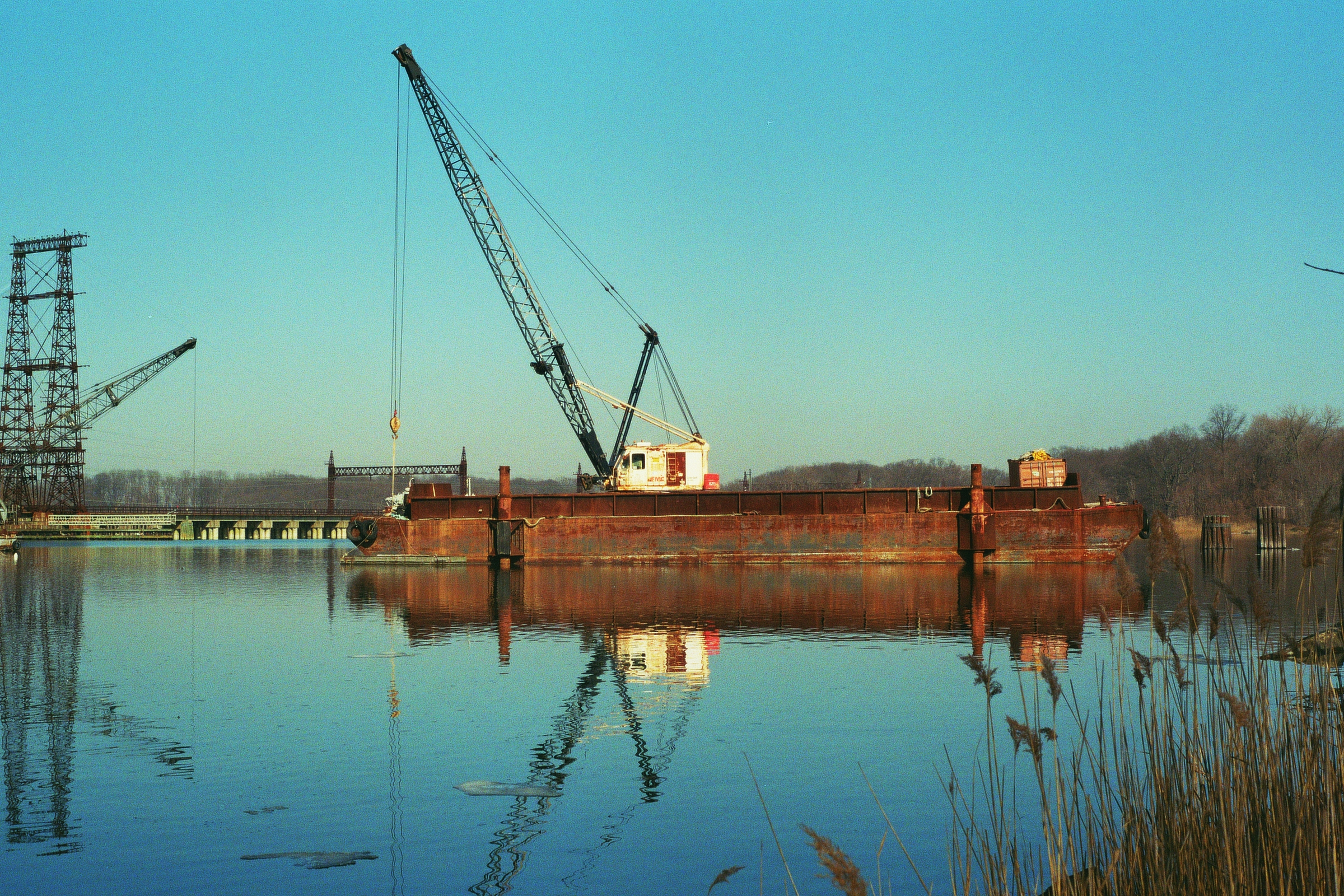 One of several rusted, abandoned ships in the Hutchinson River. The Bronx.  Kodak Ultra Max 400. Pentax K1000. Fletcher Berryman 2019.