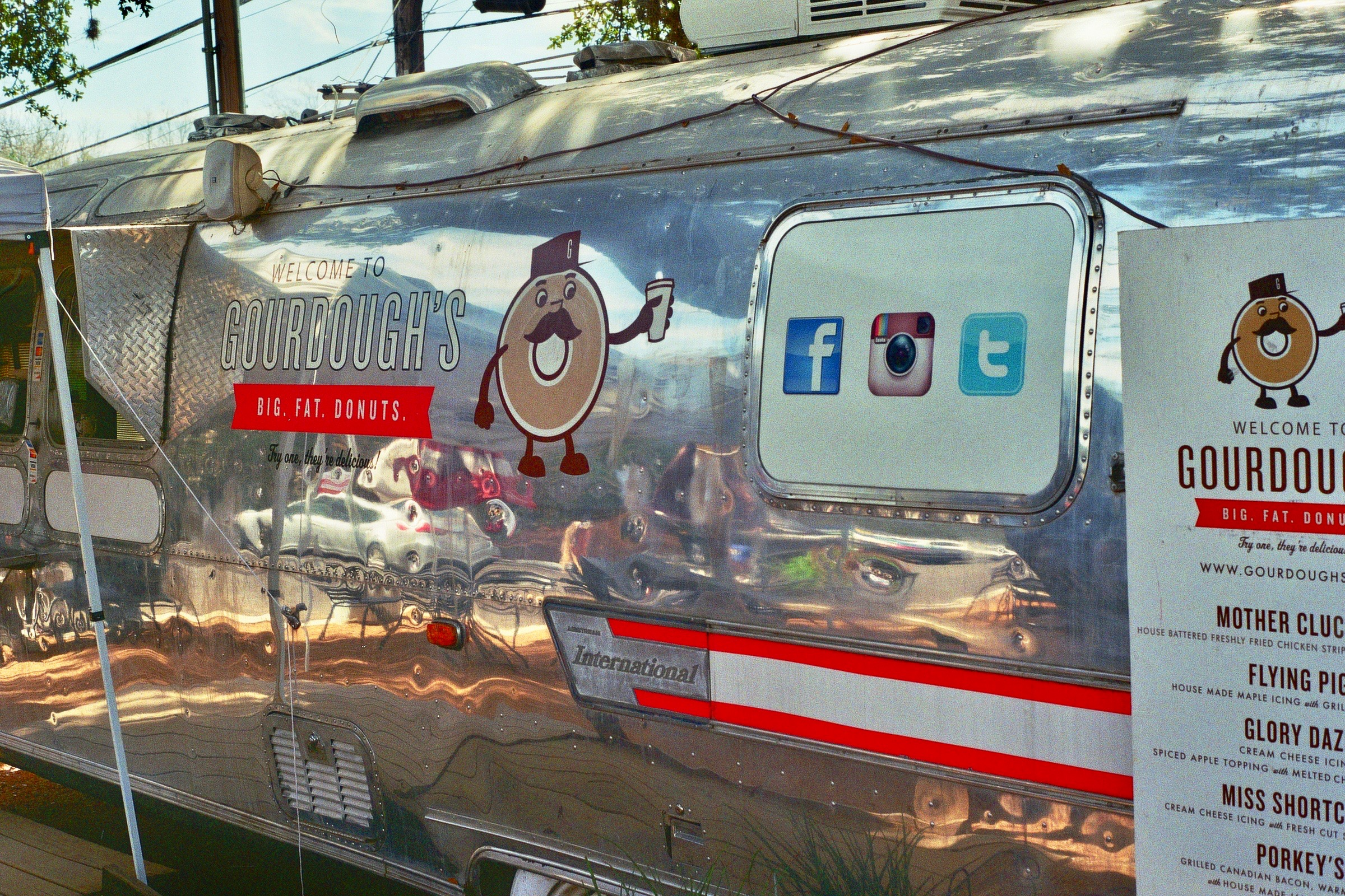 Big Fat Donuts, a donut-serving Airstream with donuts lathered in everything from bacon to strawberry jam to fried chicken.  Austin, TX  Kodak Ultra Max 400. Pentax K1000. Fletcher Berryman 2019.